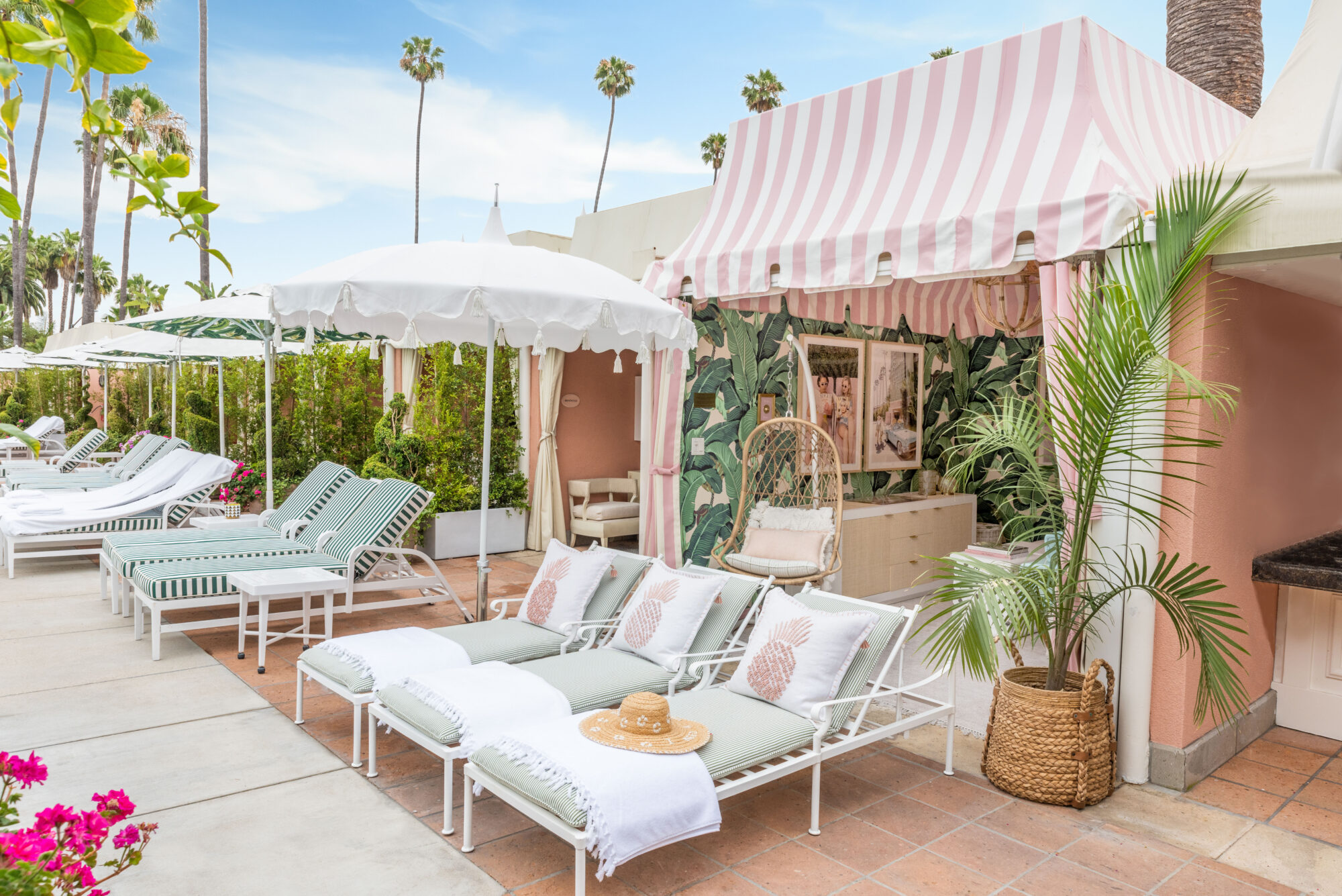 Tall palm trees poke out of the backdrop behind the retro cabana