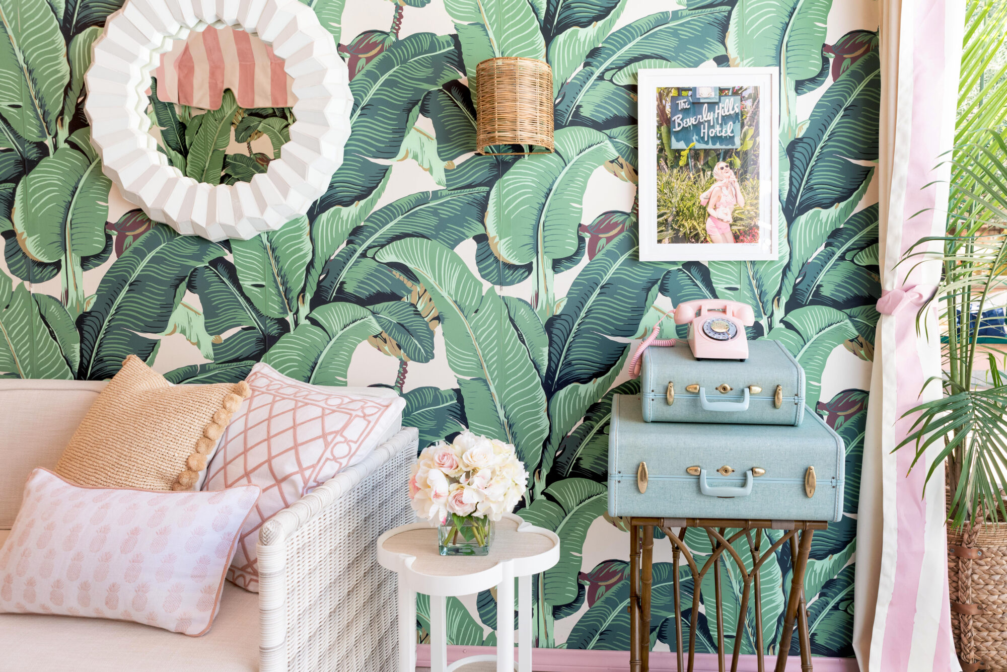 Vintage 1950 decor stands against the banana leaf wallpaper