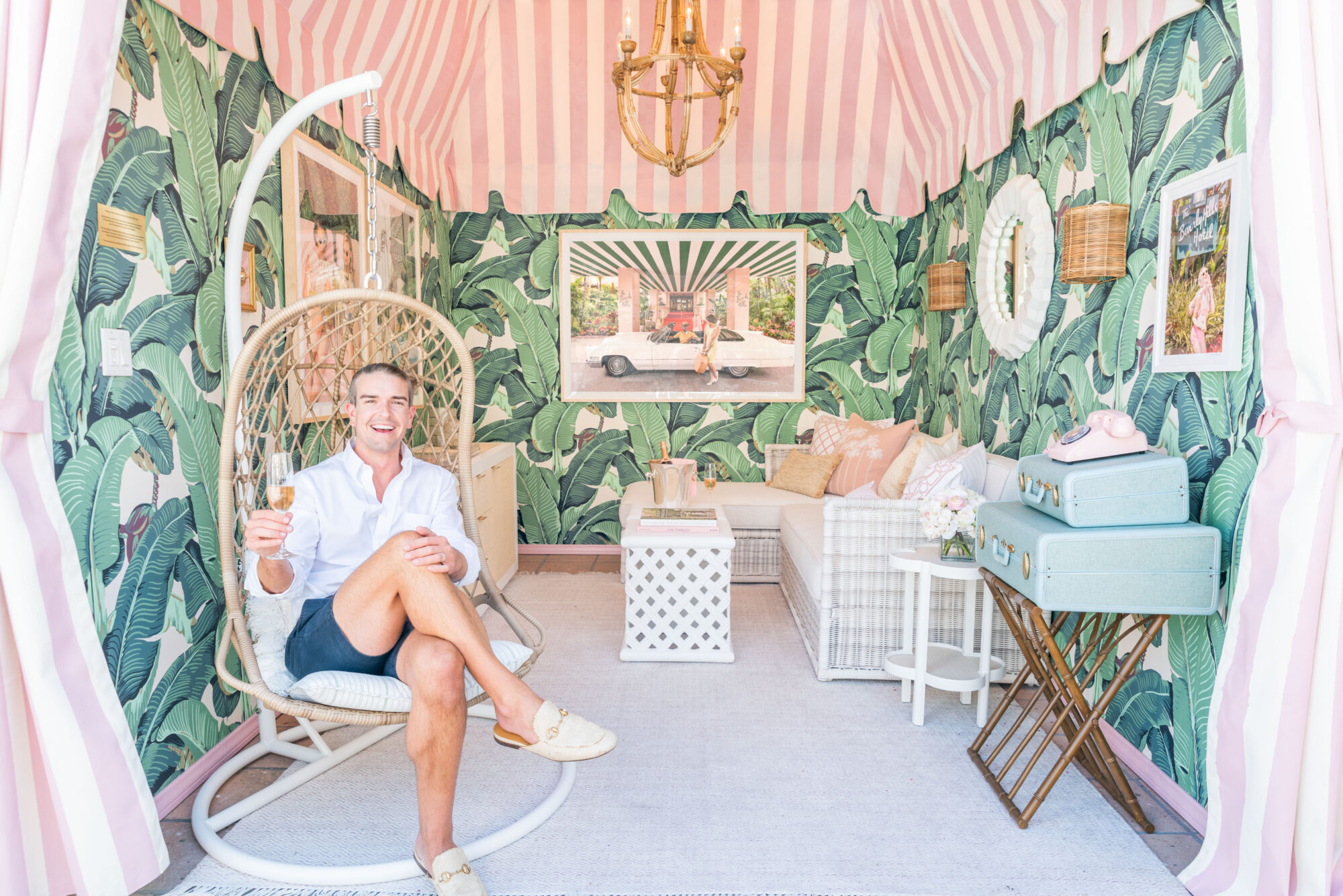 Gray Malin sits among his finished cabana