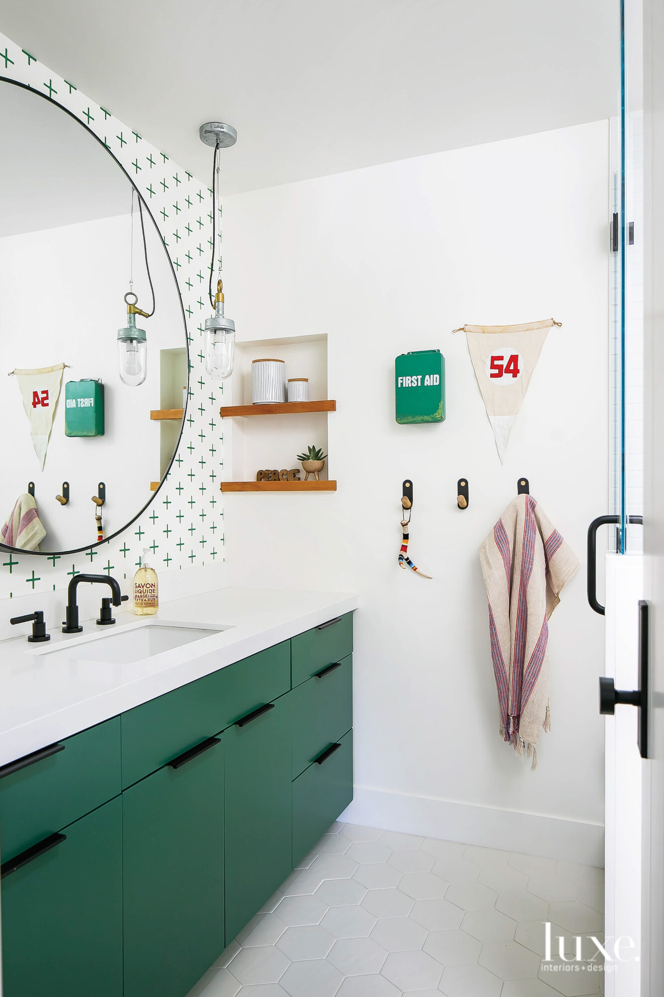 Bathroom with green vanity and...