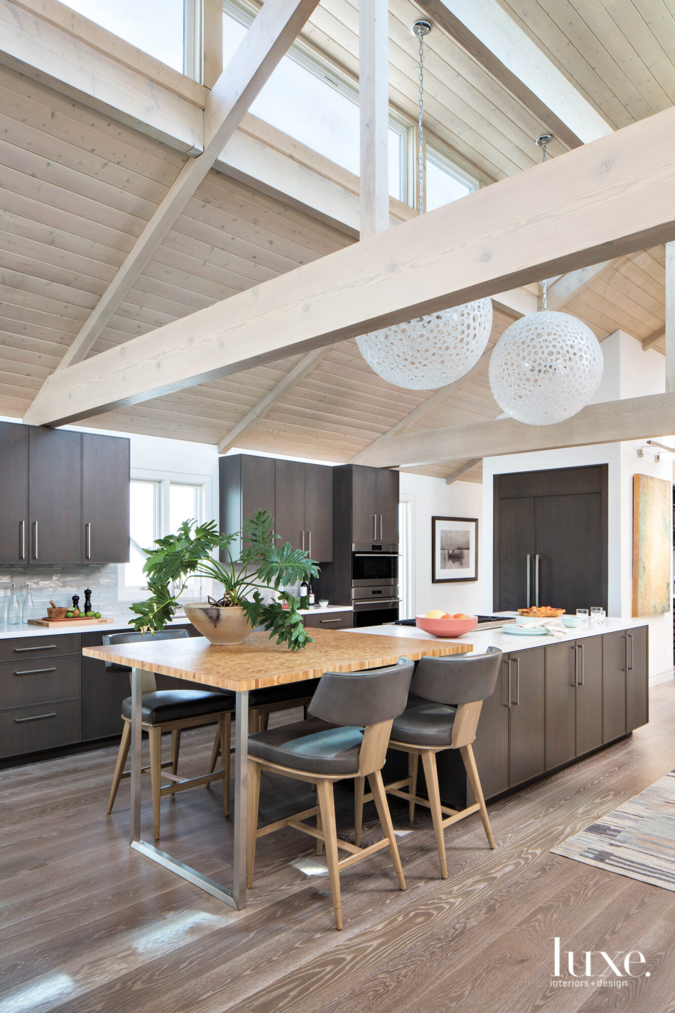 Shot of kitchen with round pendants above the island