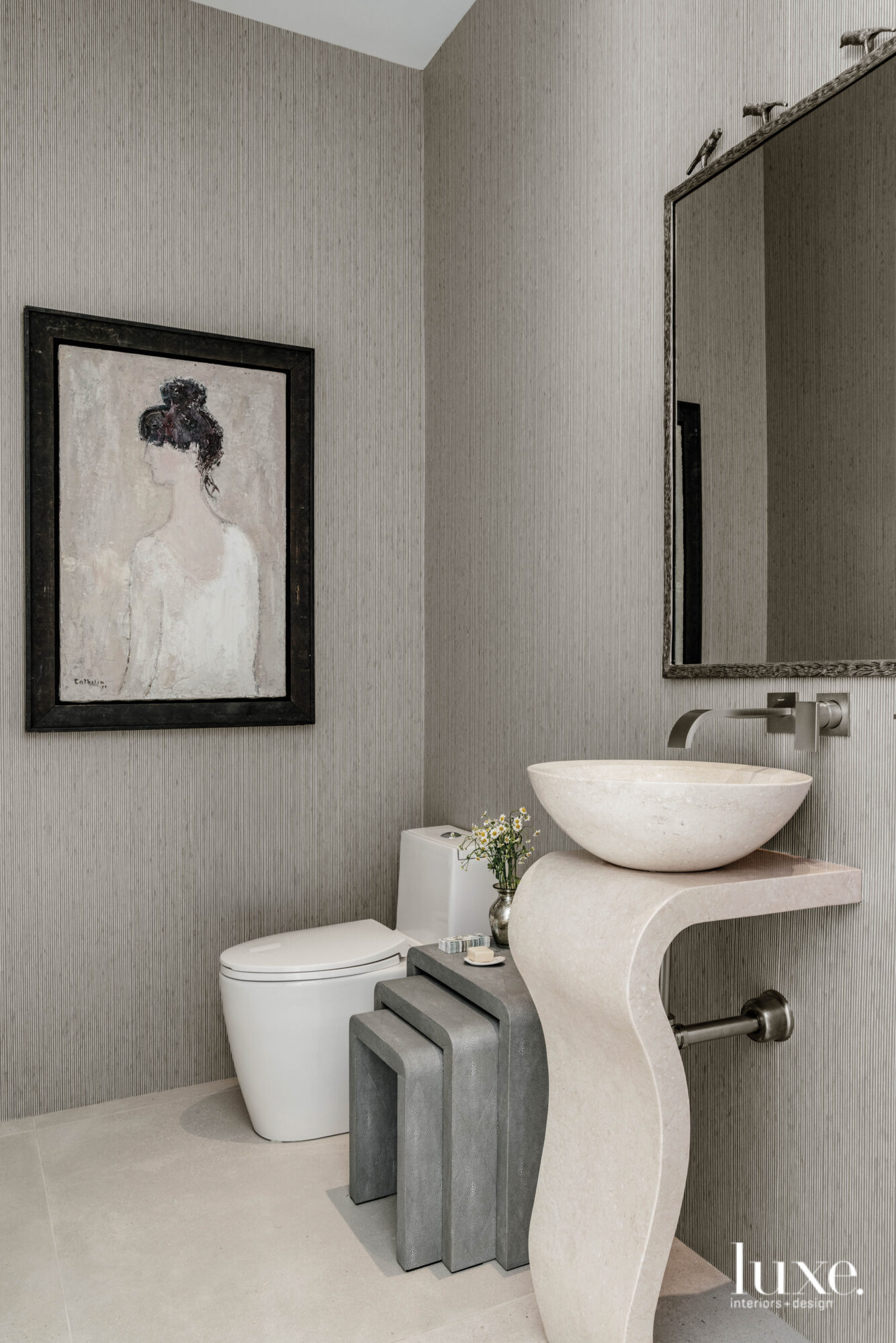 Powder room with sculptural sink.