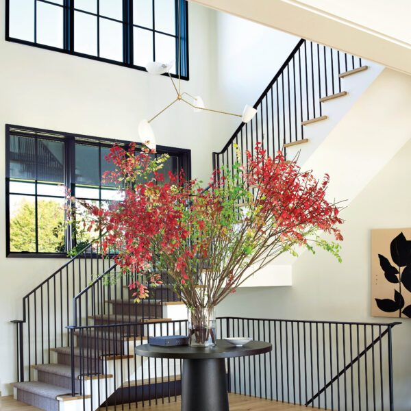 East Coast Tradition Meets West Coast Chill In A Youthful Hamptons Abode Black and white colors contrast in the entryway