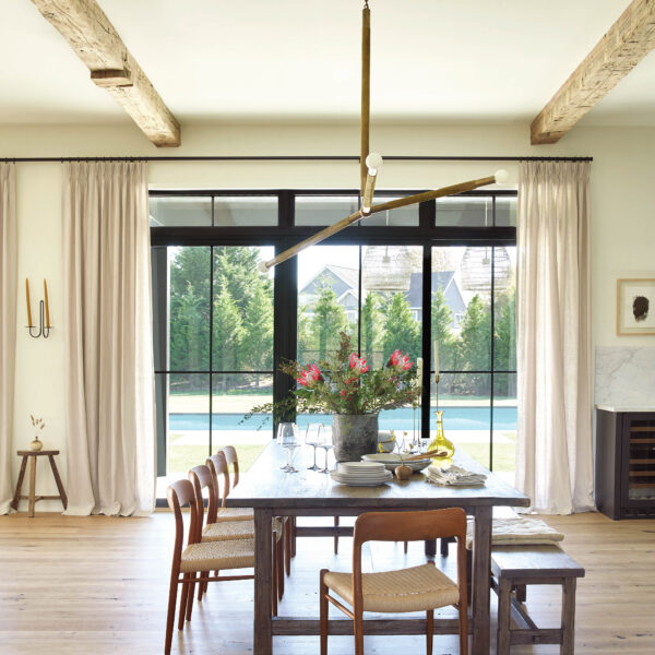 East Coast Tradition Meets West Coast Chill In A Youthful Hamptons Abode The dining room sits in front of a view of the pool