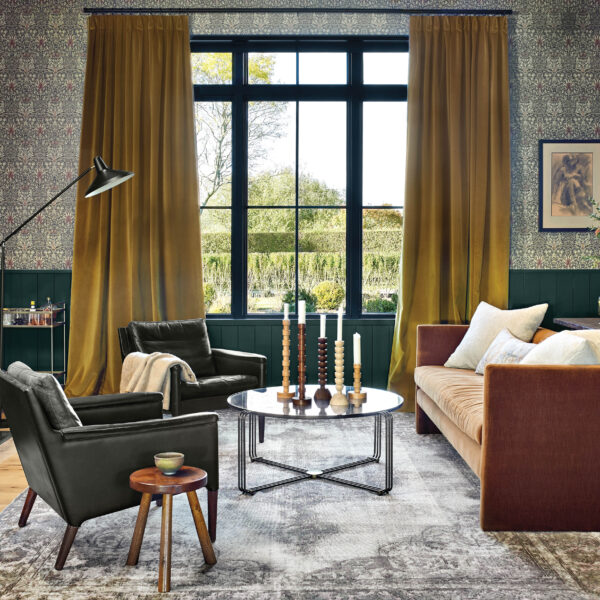 East Coast Tradition Meets West Coast Chill In A Youthful Hamptons Abode This dark den contrasts to the bright central living room