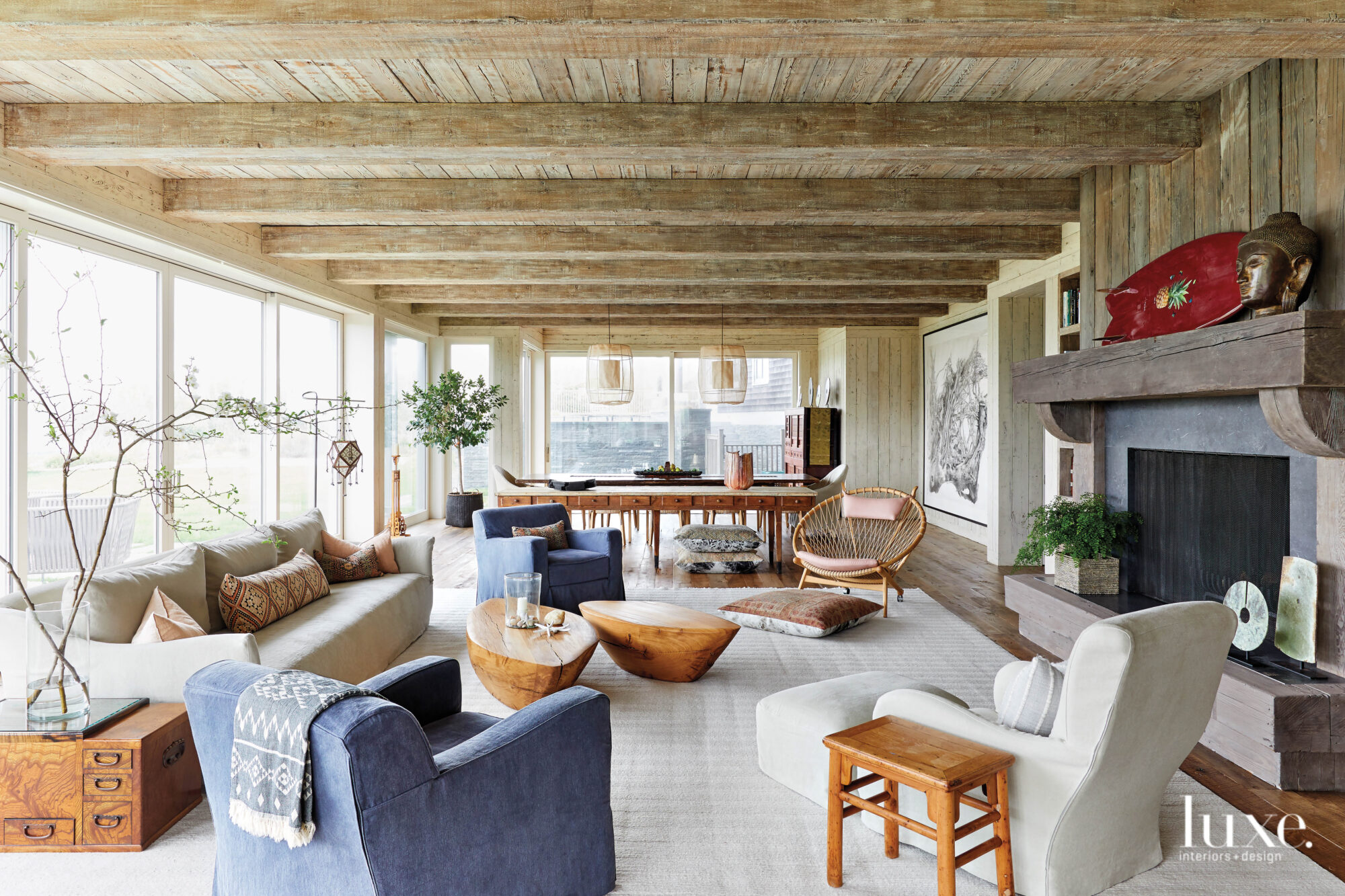 Beachy wood planks define the cieling in the spacious living room