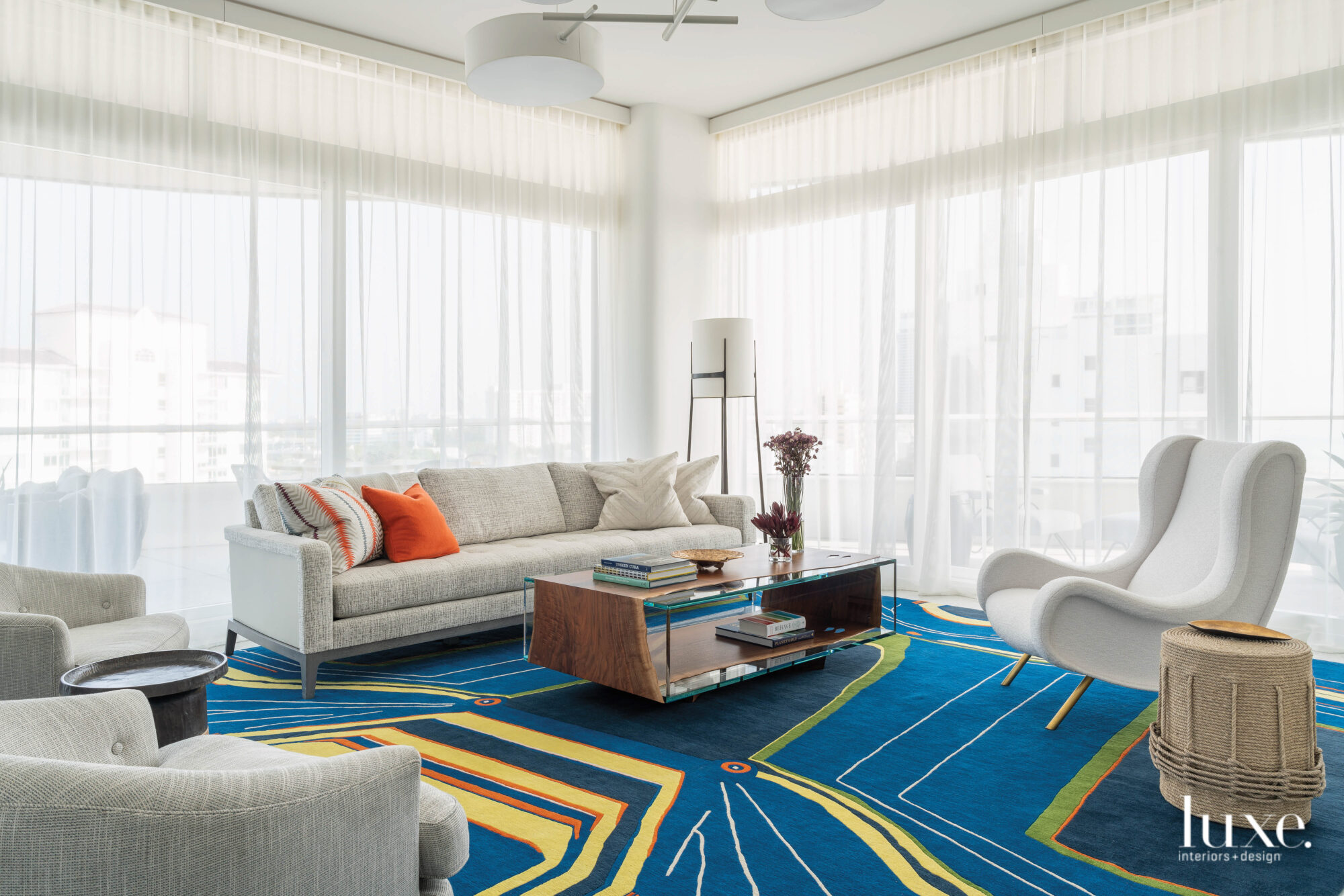 Living room with bold blue and yellow rug