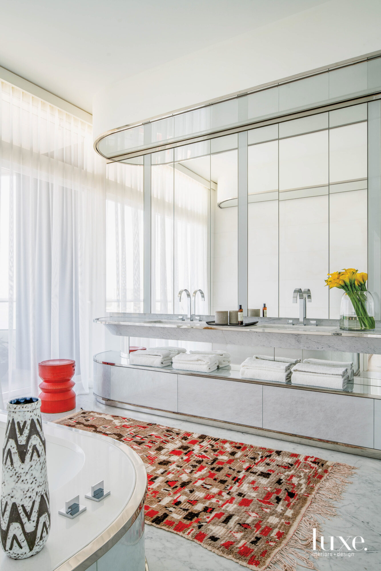 Master bathroom with bold red...