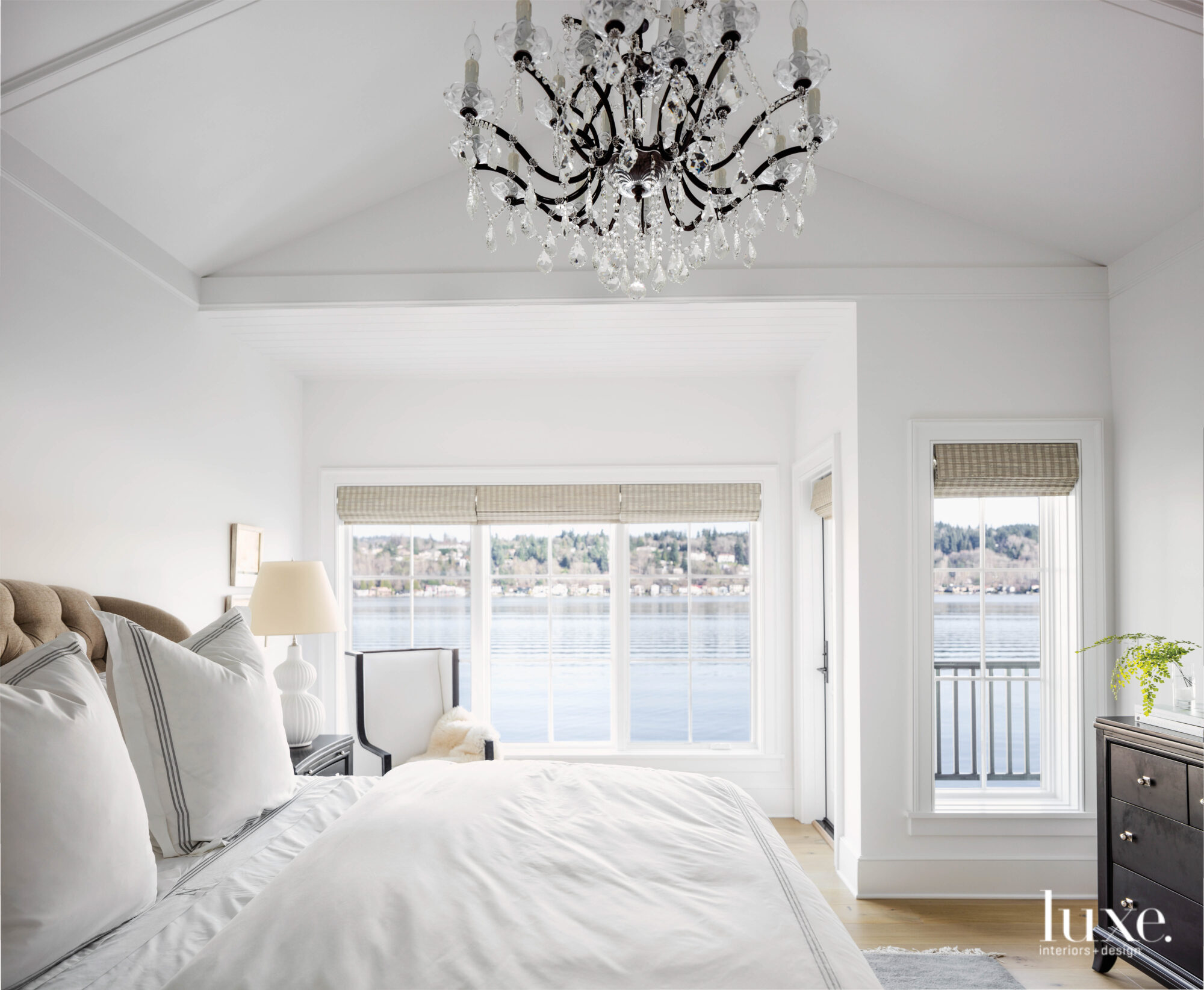 Master bedroom with crystal chandelier...