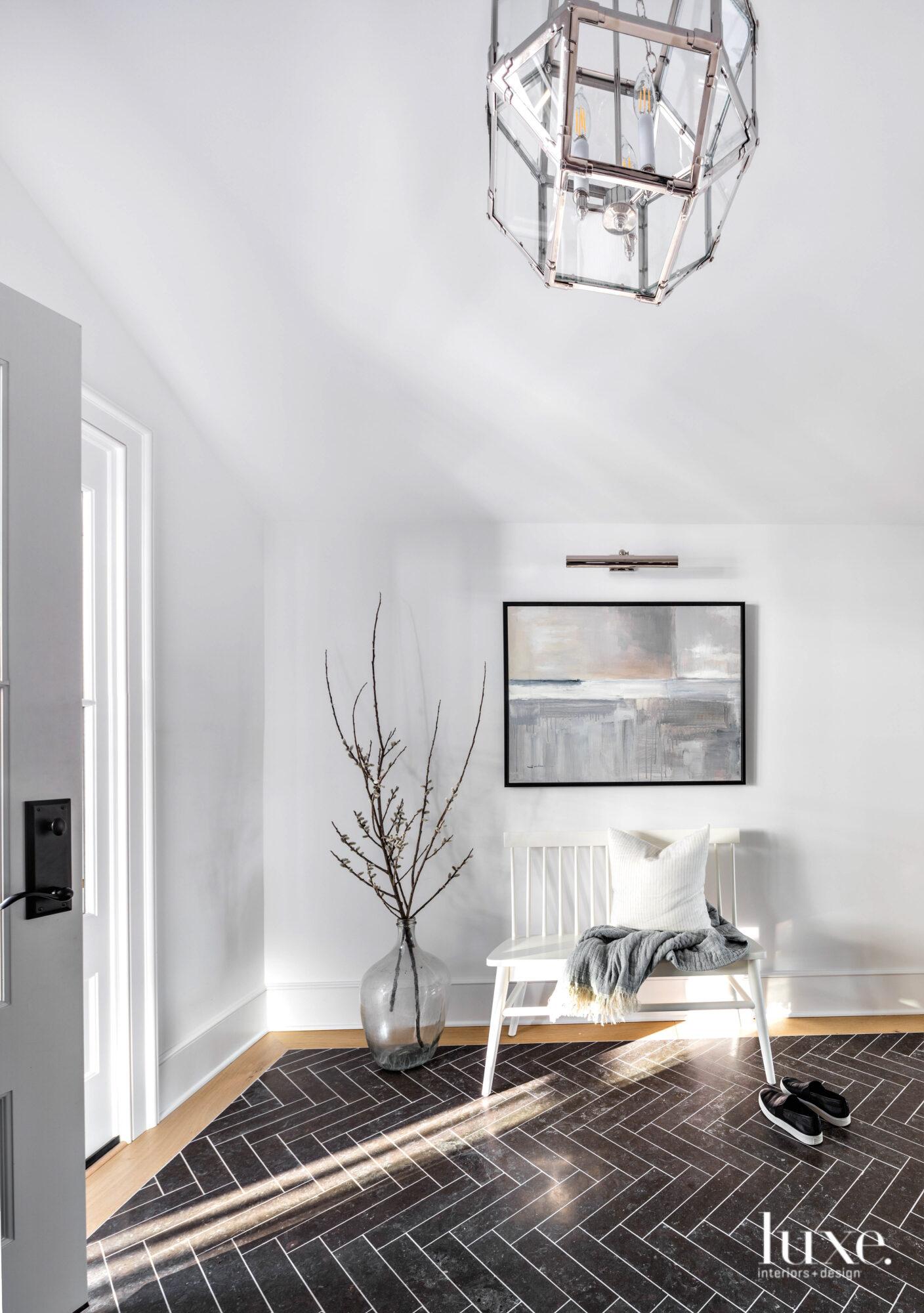 Foyer of home with herringbone...