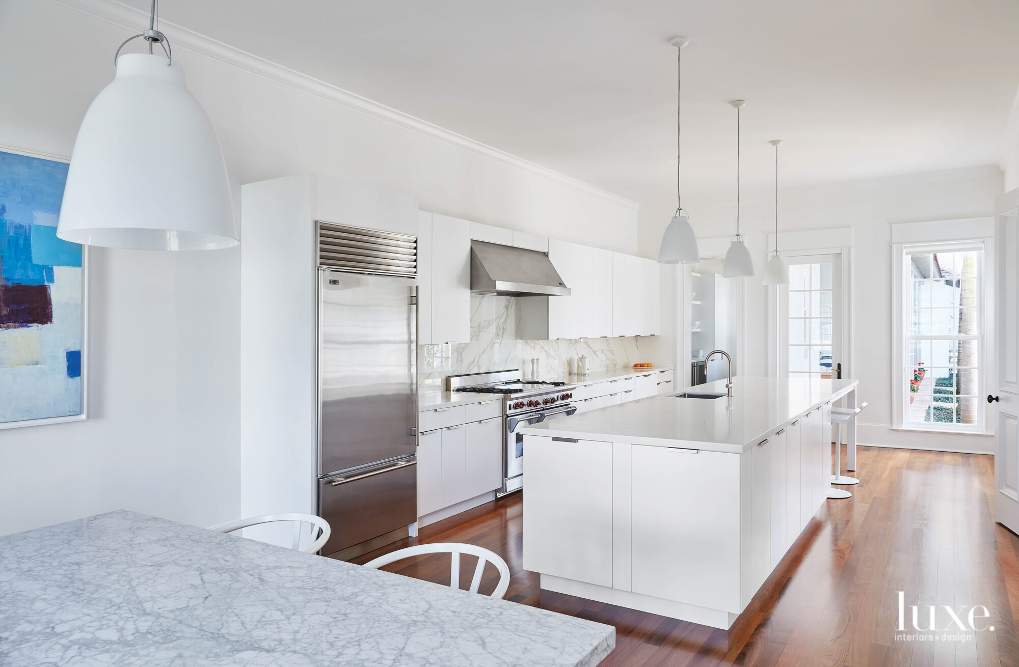 Kitchen with white cabinetry and...