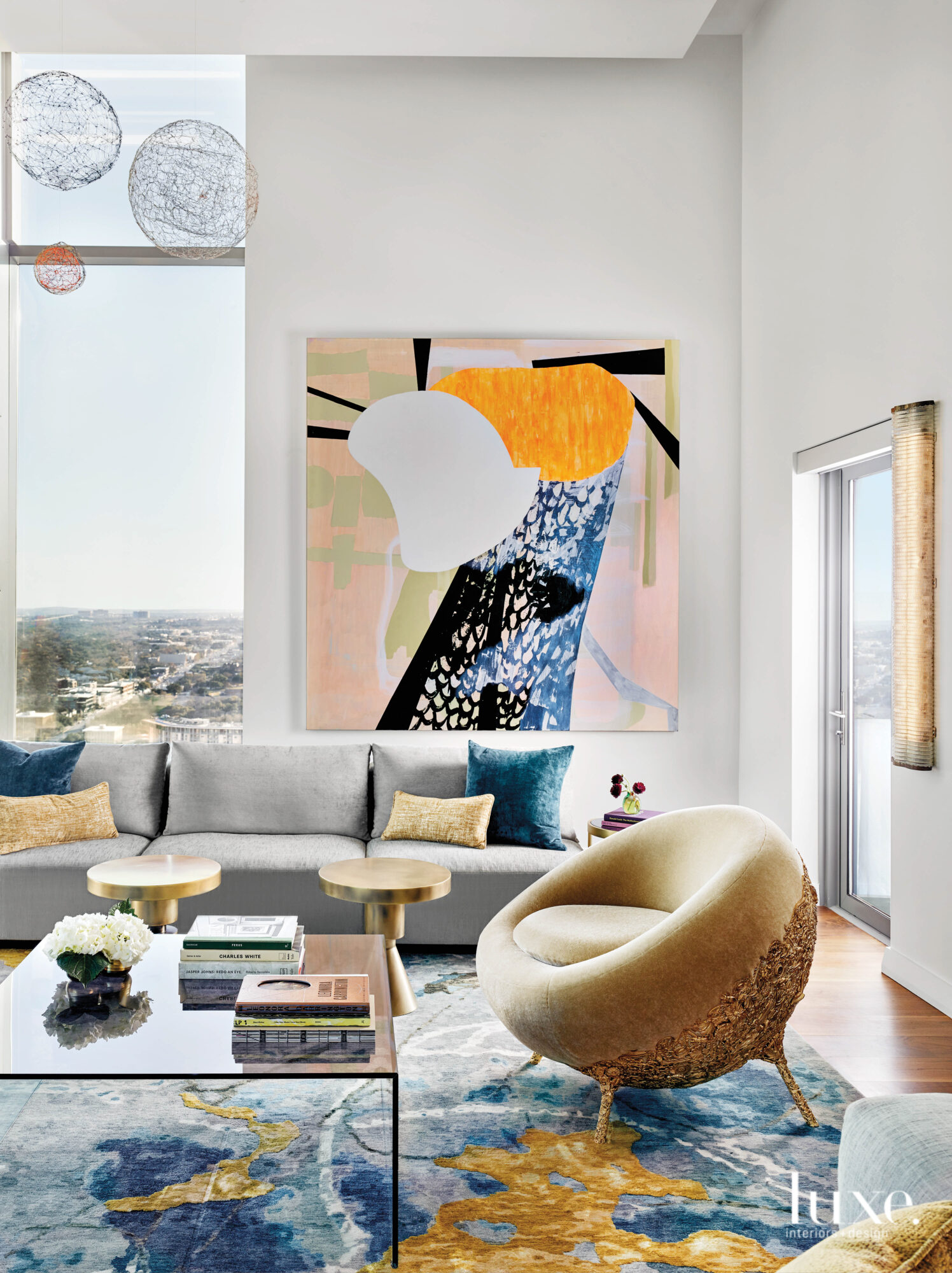 Art-filled living room with sculptural...