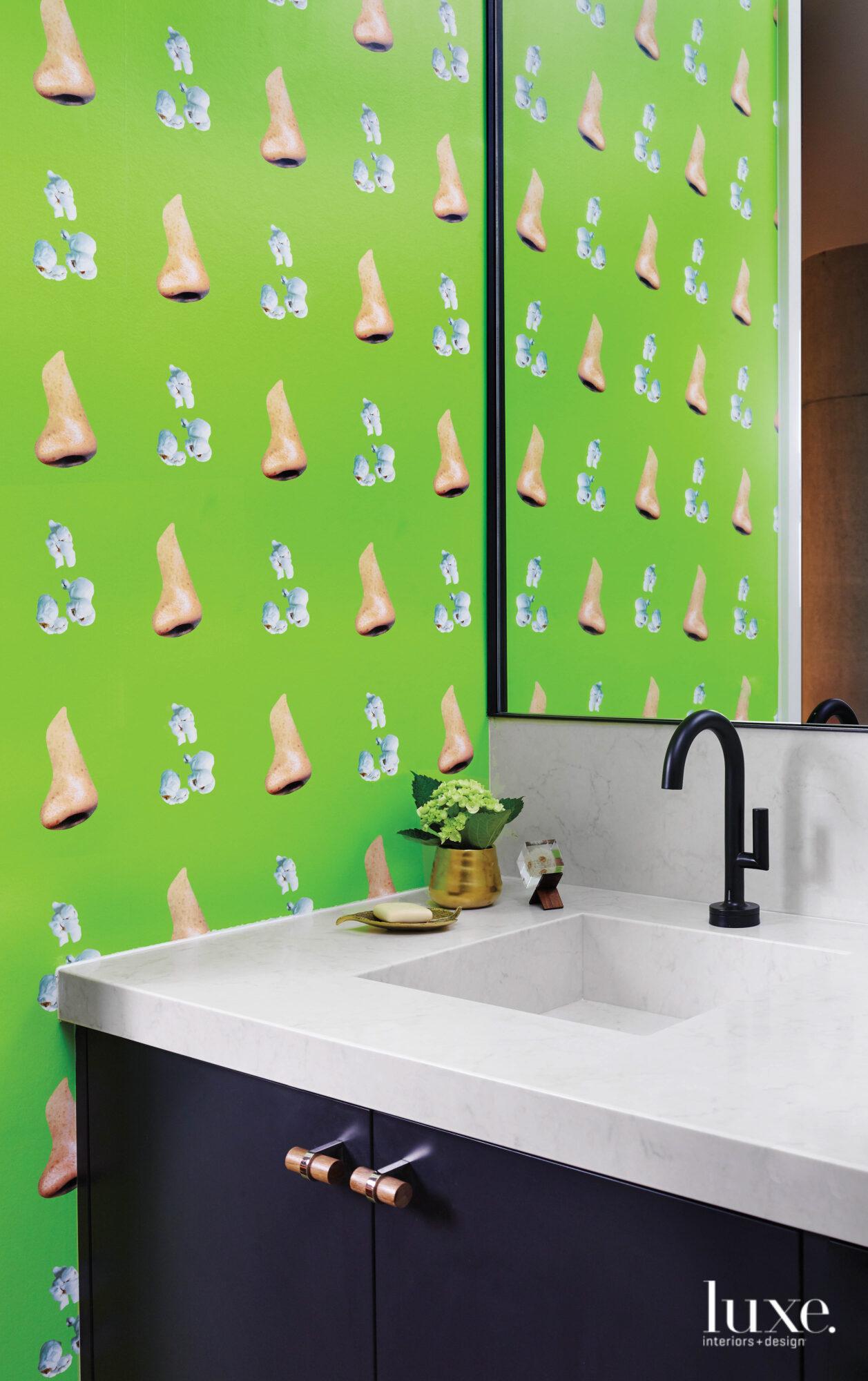 Cheeky powder bathroom with wallpaper...