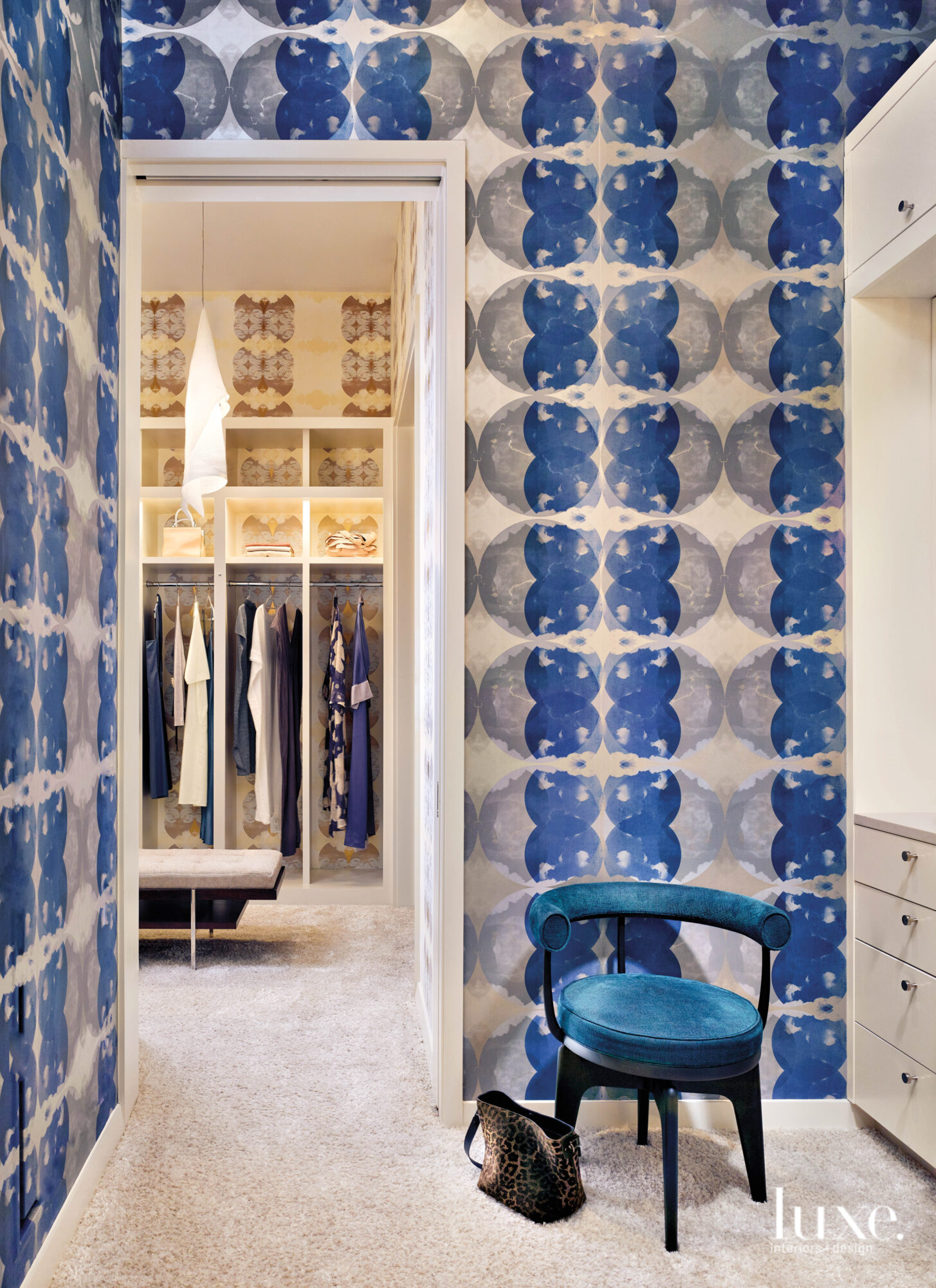 Walk-in closet with wallpaper inspired...