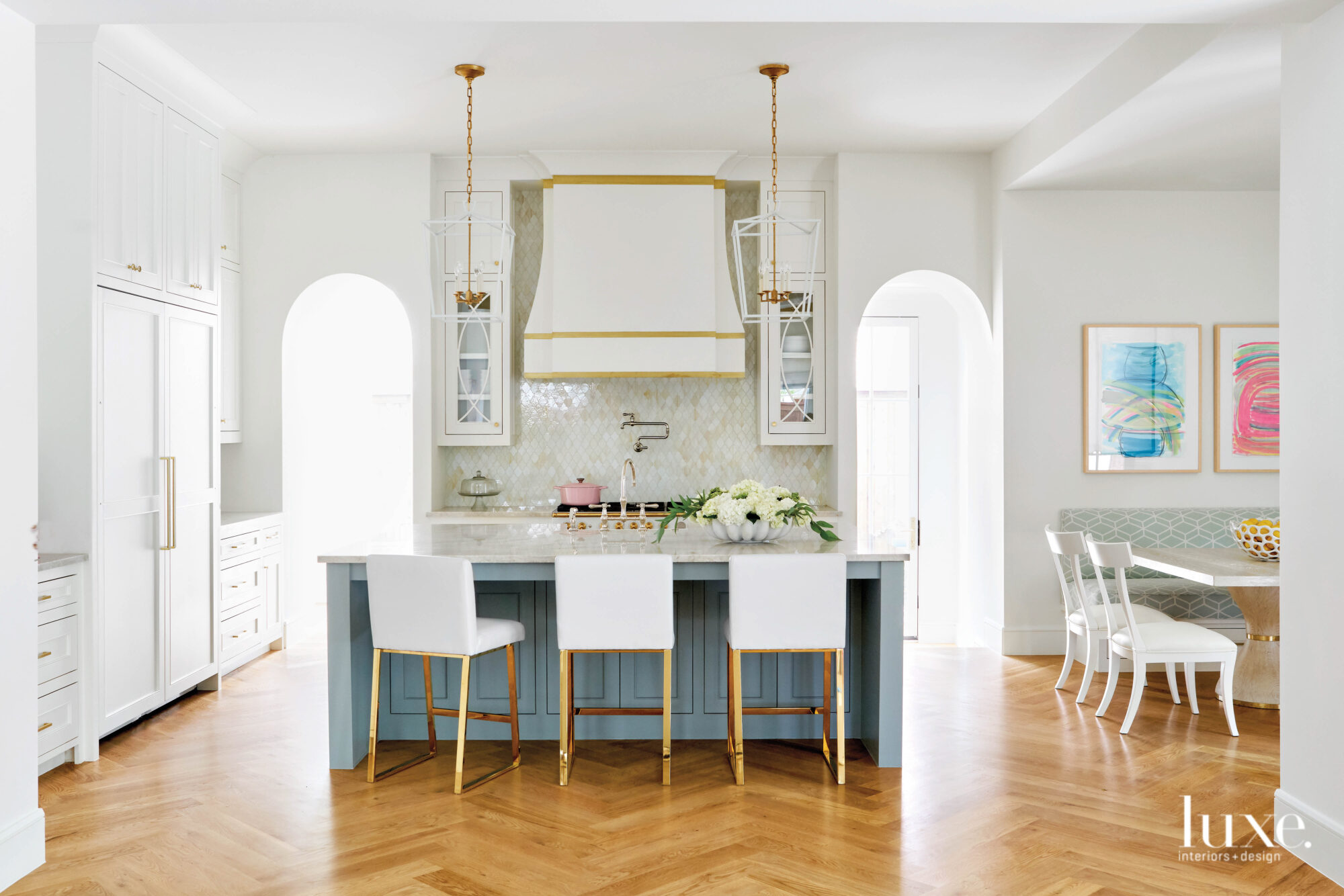 Cheerful kitchen with statement venthood...