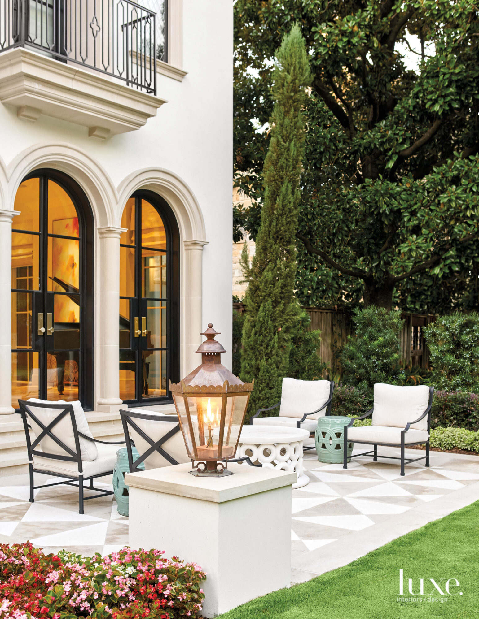 Entertaining terrace with limestone pavers and a seating area.