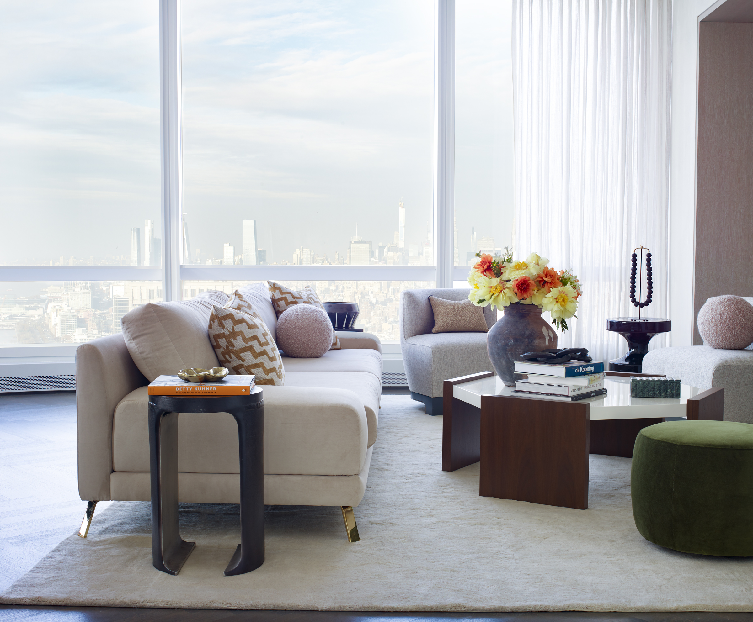 Living room of 111 Murray Street with a city view through the enormous window