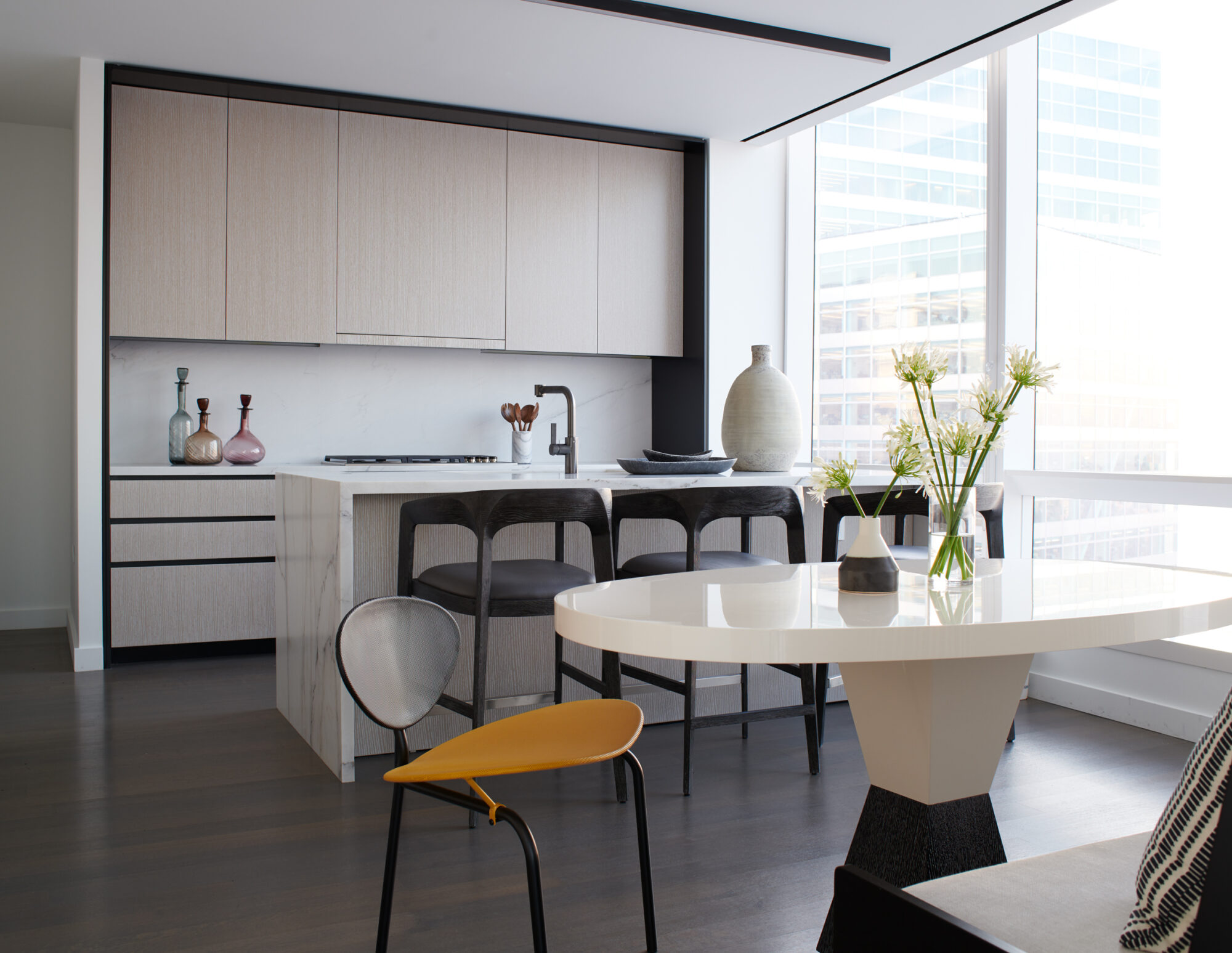 A simple, neutral-toned kitchen showcases the open floor plan