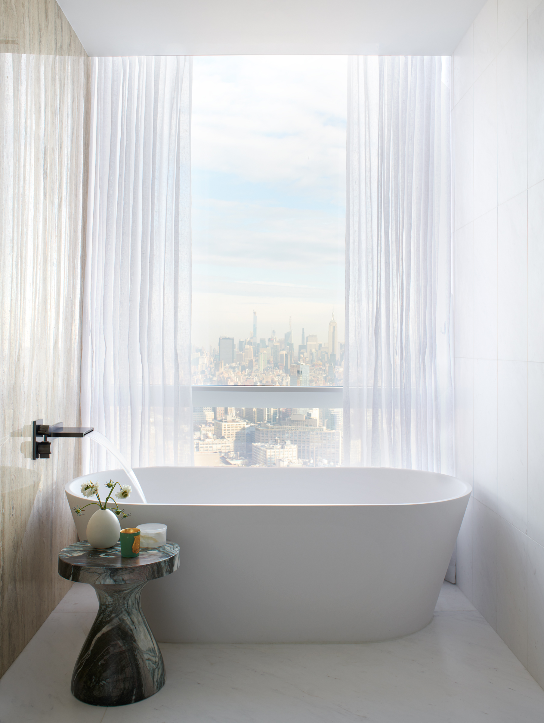 The city skyline is the perfect backdrop, even behind the bathtub