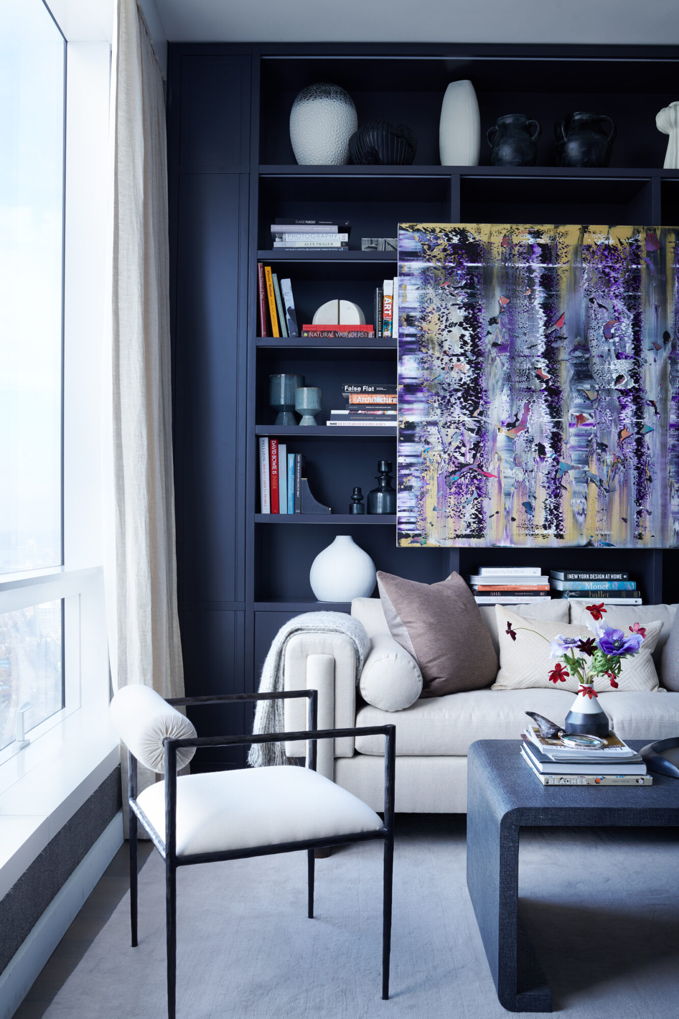 Natural light brightens up a seating area with dark hues