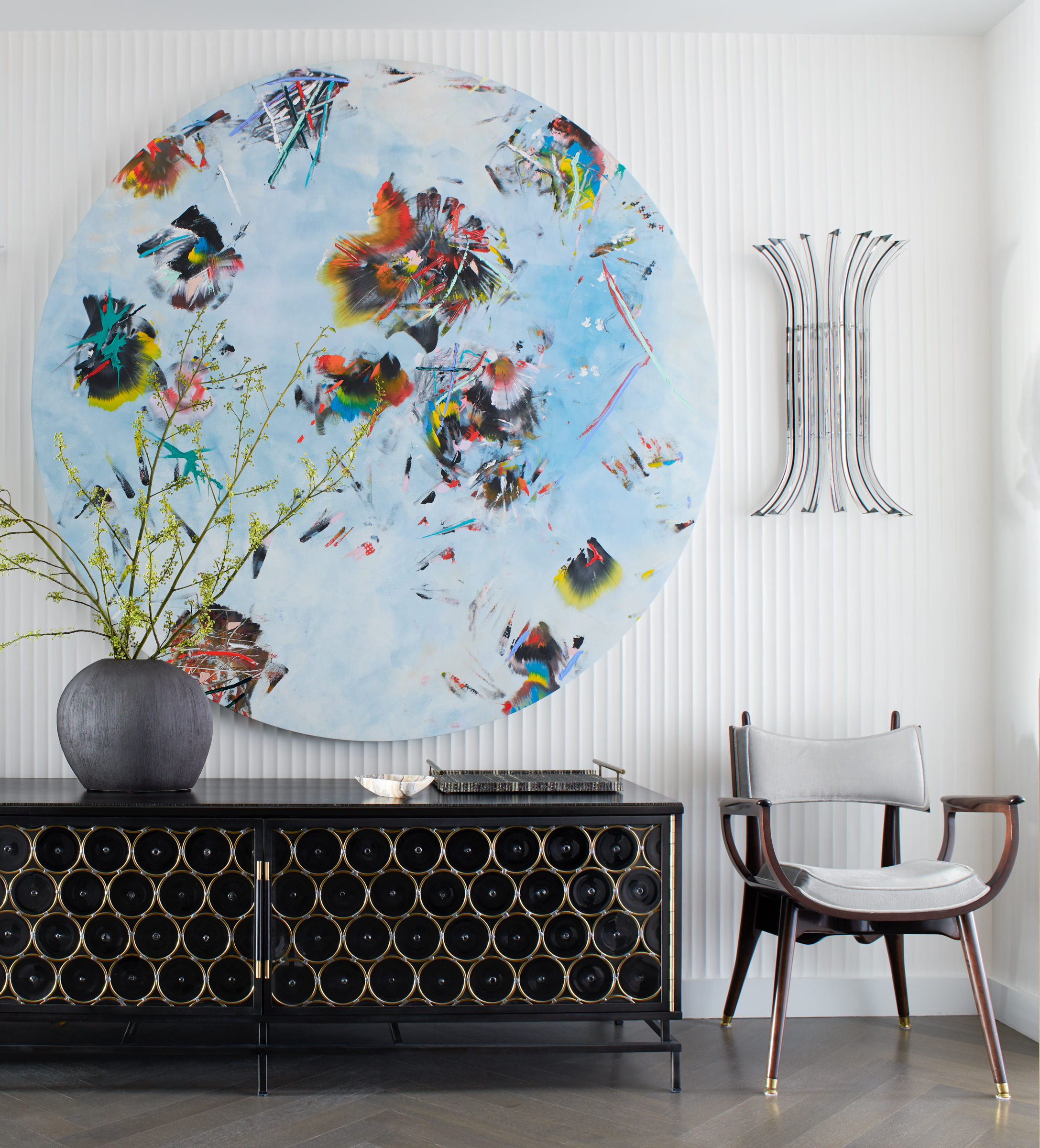 A vibrant blue floral art piece sits in a foyer