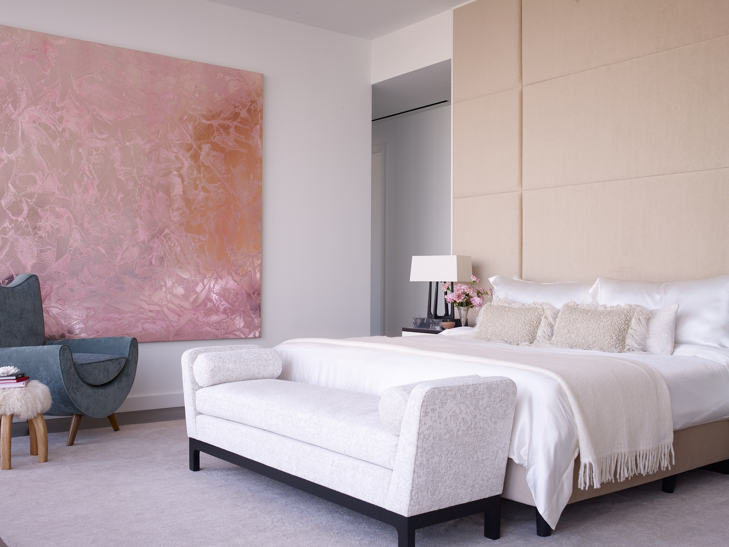 Different shades of pink define this spacious bedroom