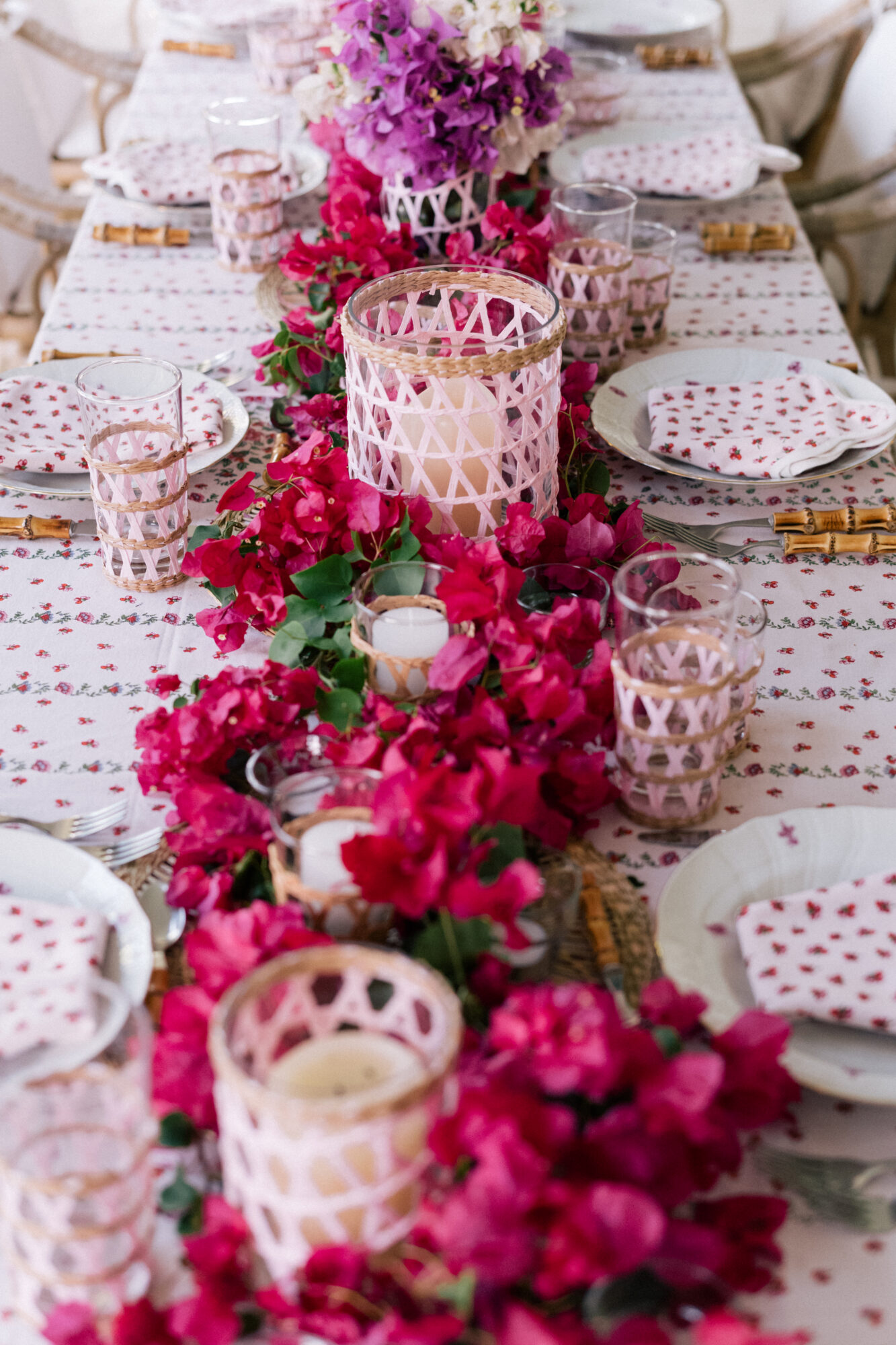 The set table beams with florals and stunning decor pieces.