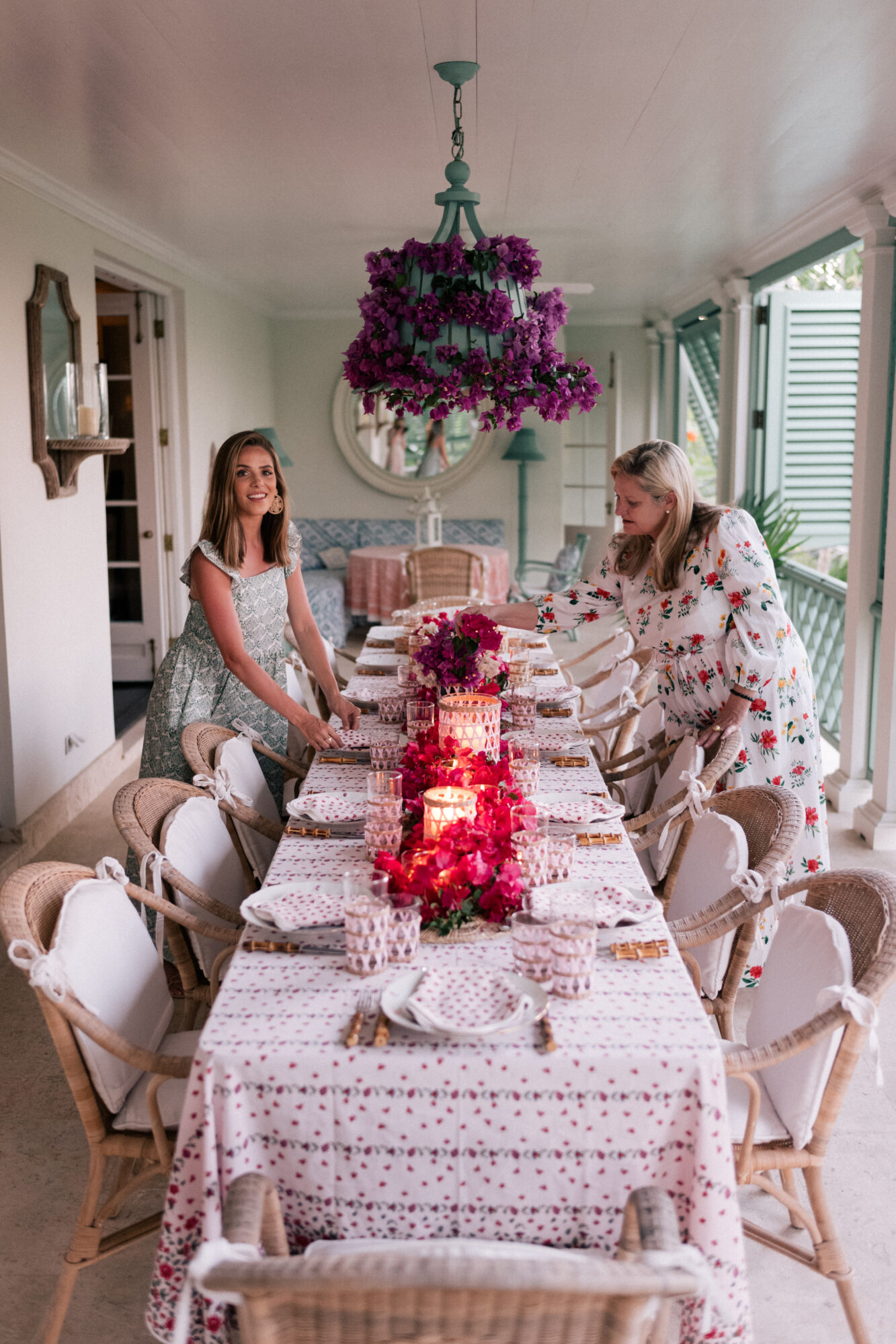 Amanda Lindroth and Julia Berolzheimer stand around the dining table.