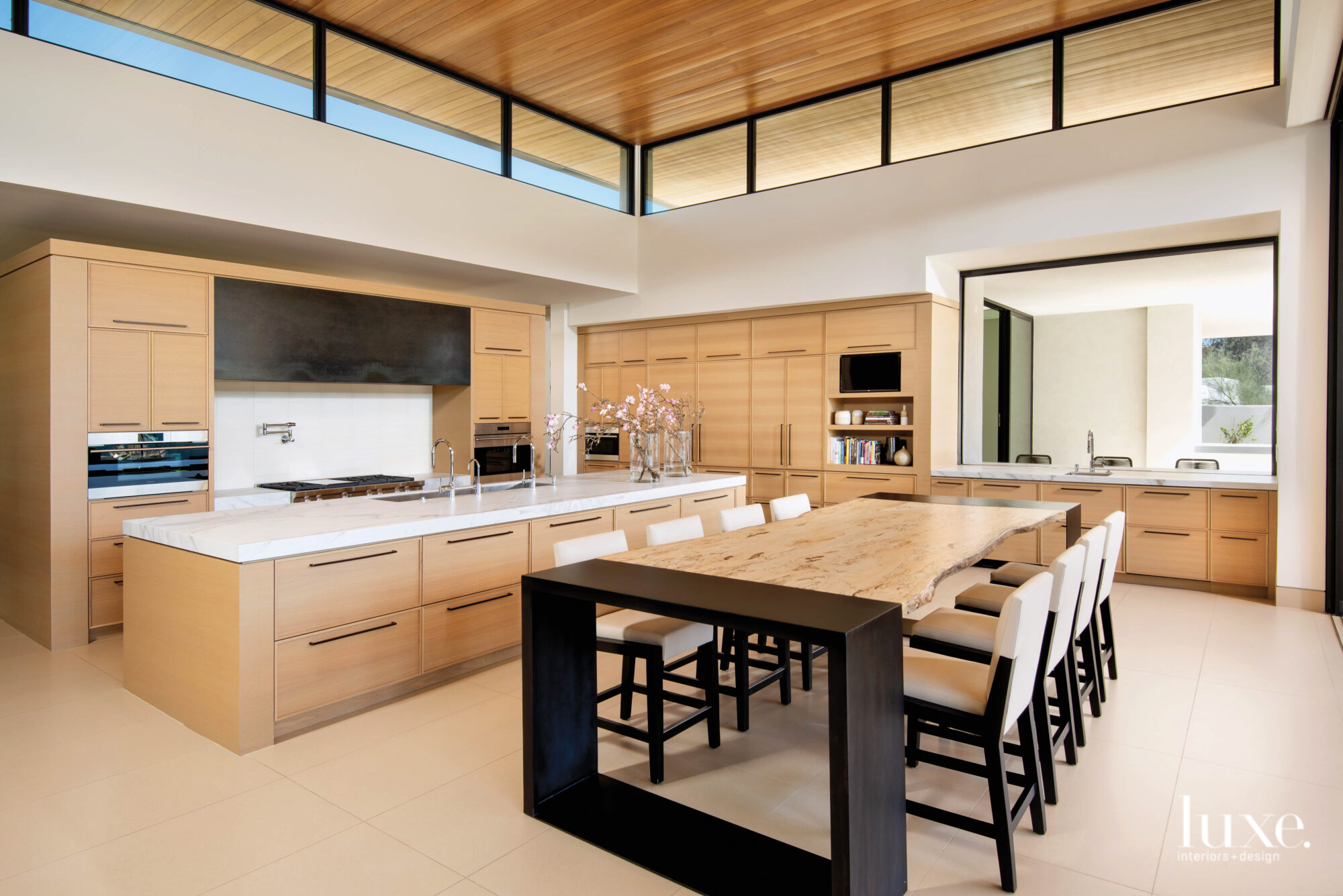 Large open-concept kitchen with a live-edge table.