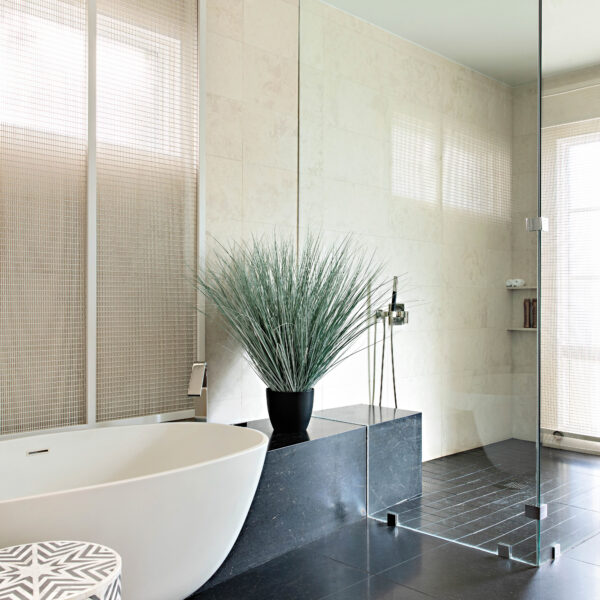 In Arizona, A Clear Vision Leads To Design That Celebrates Modern Art And Mountain Views A stand-alone tub sits in the black-tiled master bathroom.