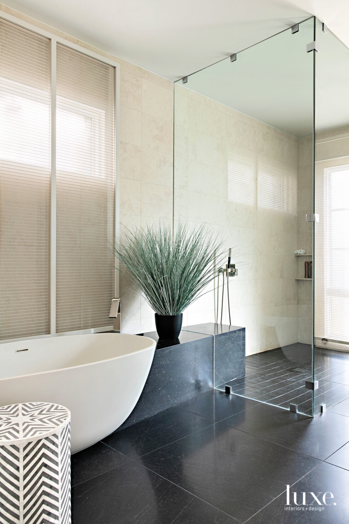 A stand-alone tub sits in...