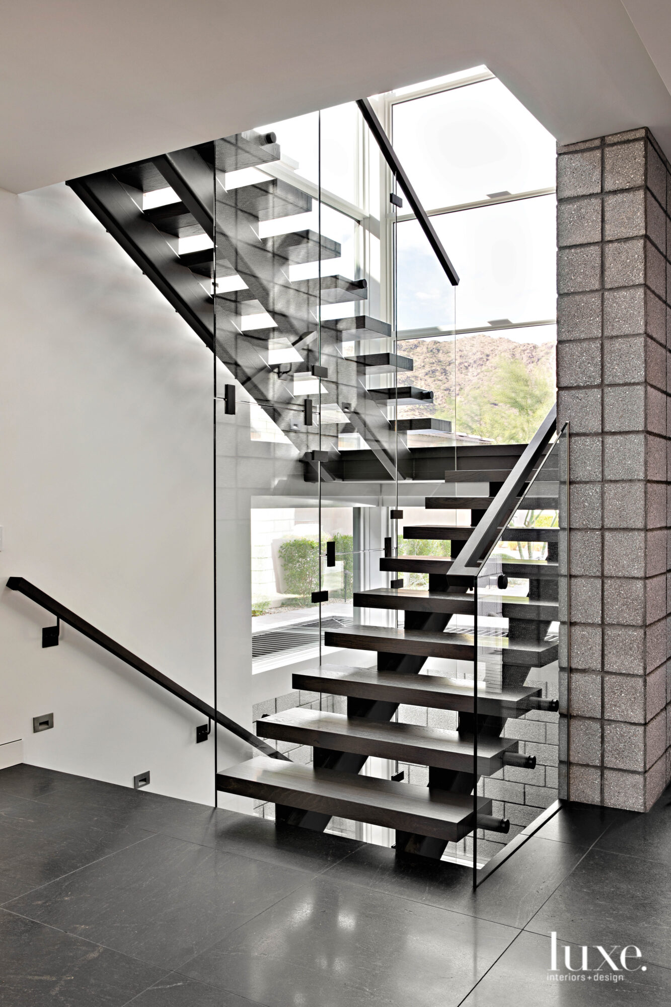 The floating staircase that provides...