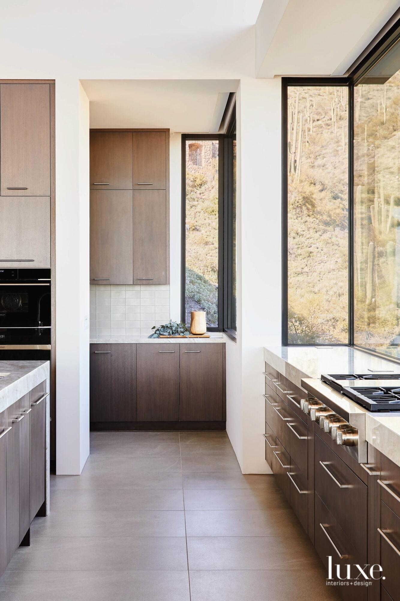 The sleek, modern kitchen has...
