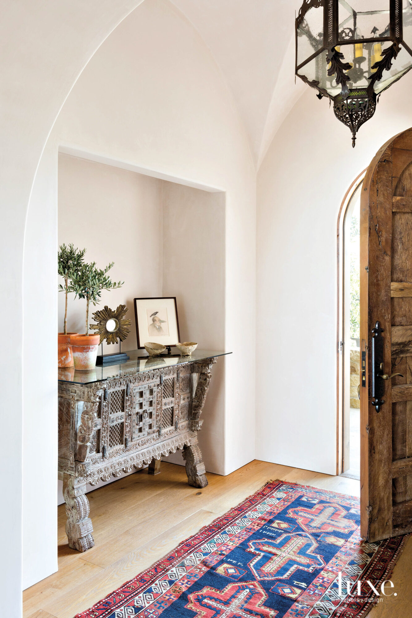 Entry with vintage chest in...