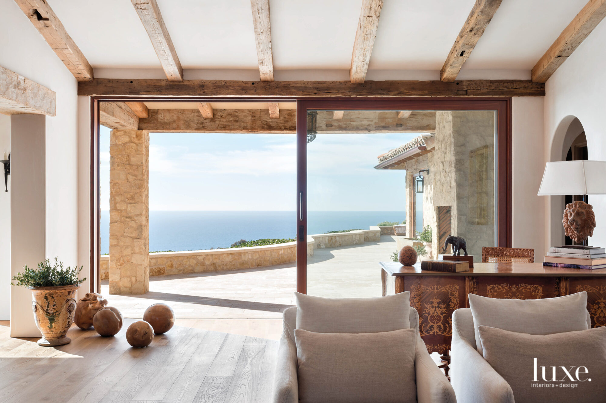 View from living room through sliders to terrace and ocean view