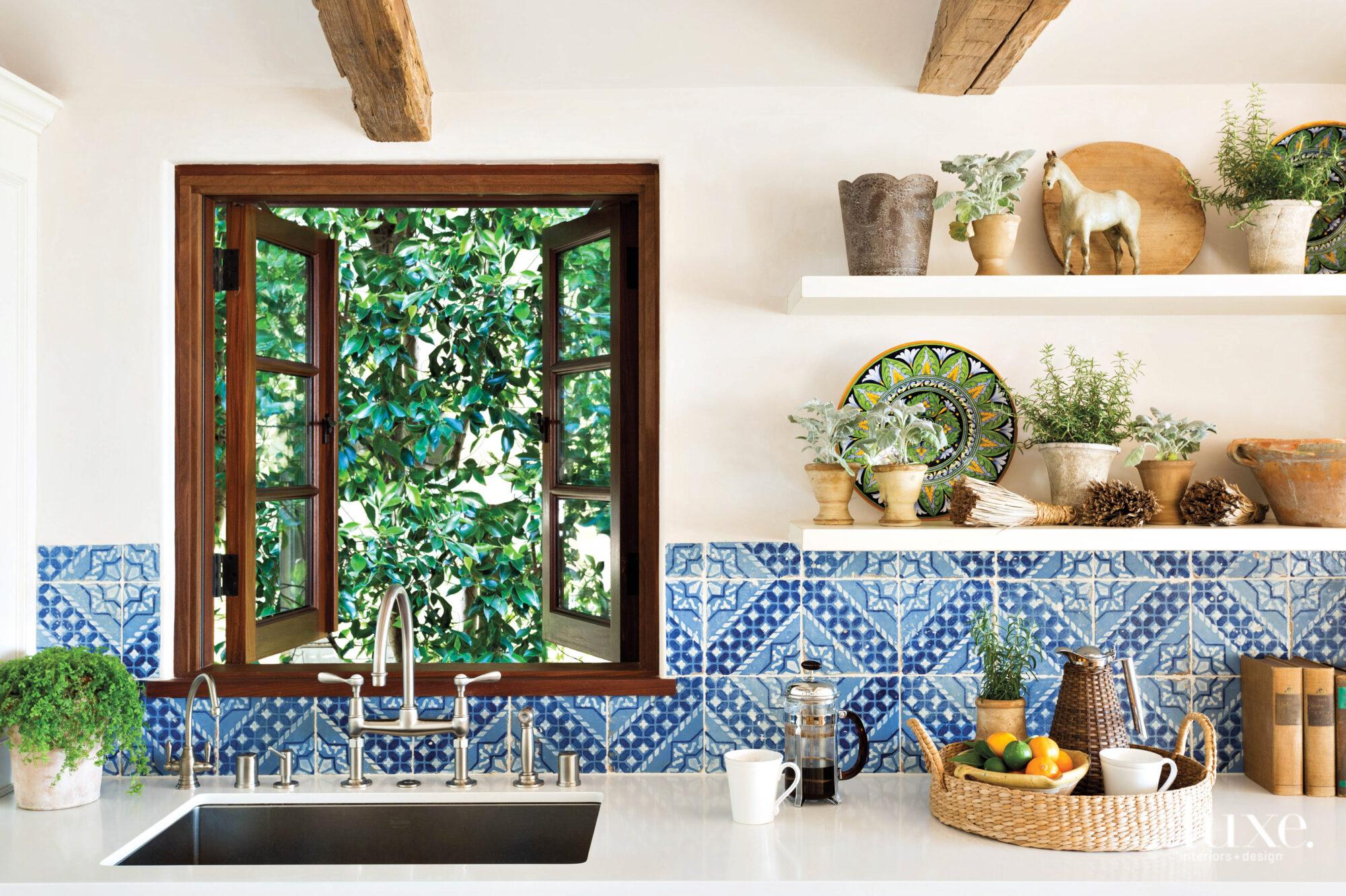 Detail shot of kitchen with blue tiled backsplash