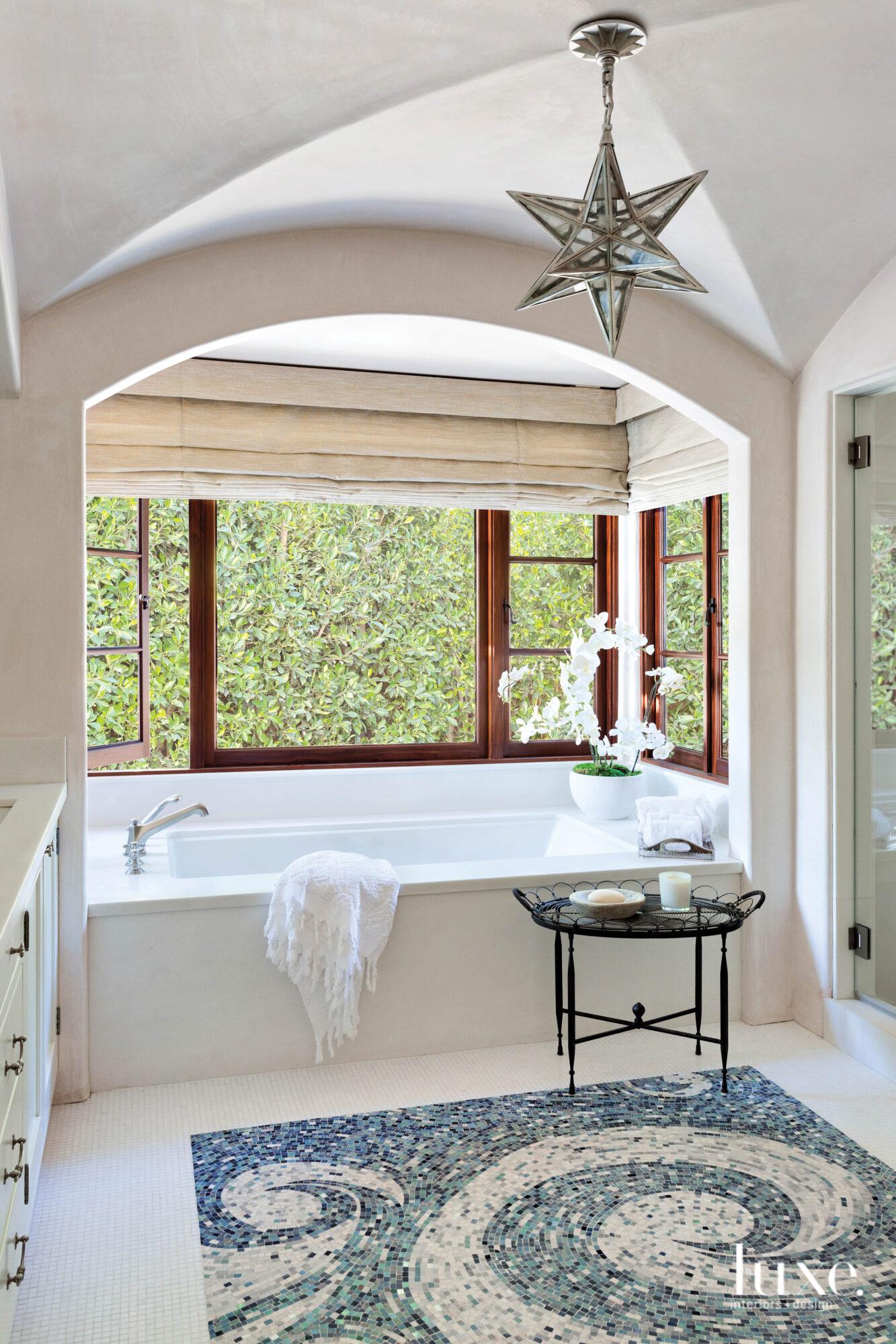 Shot of bathroom with tub...