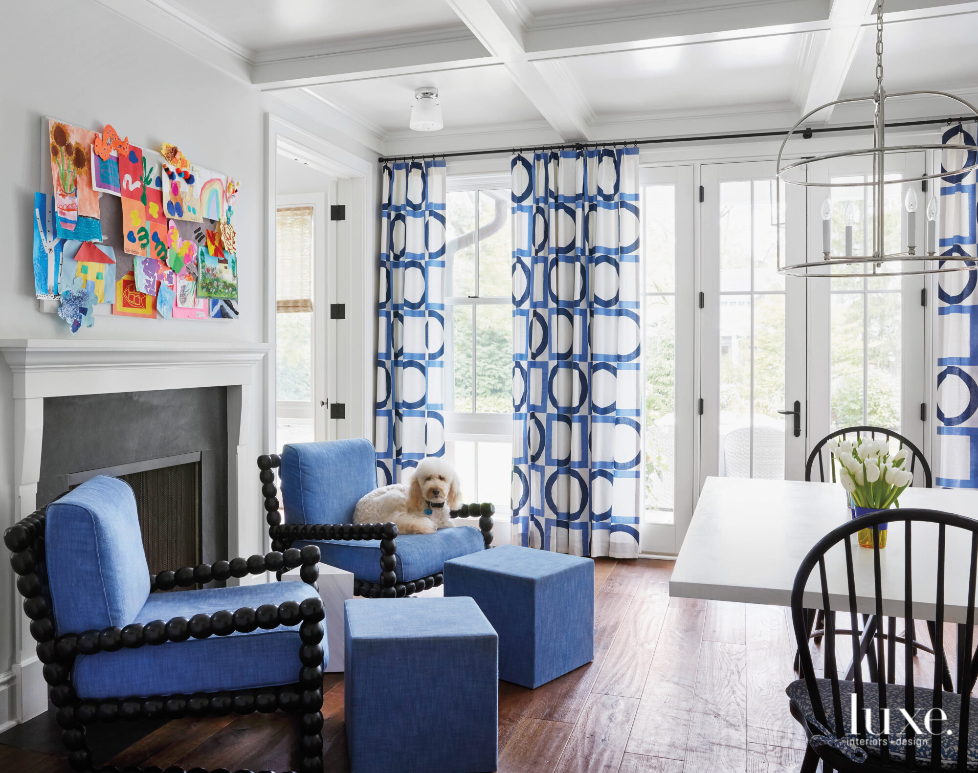 blue chairs near fireplace with...