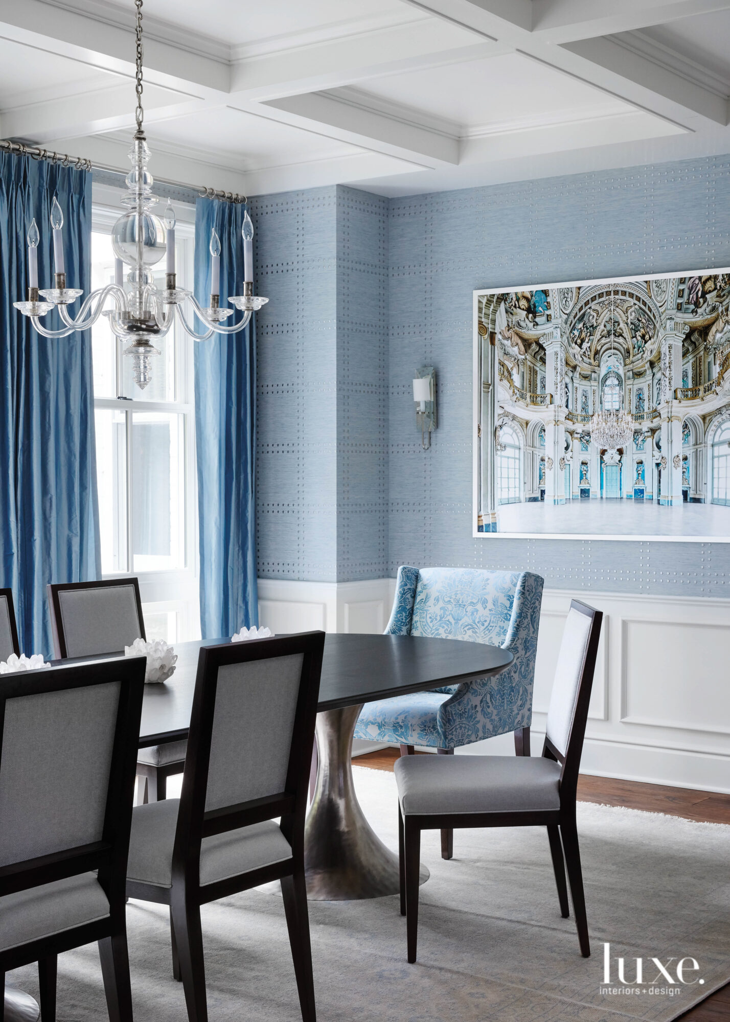 blue walls dining room with...