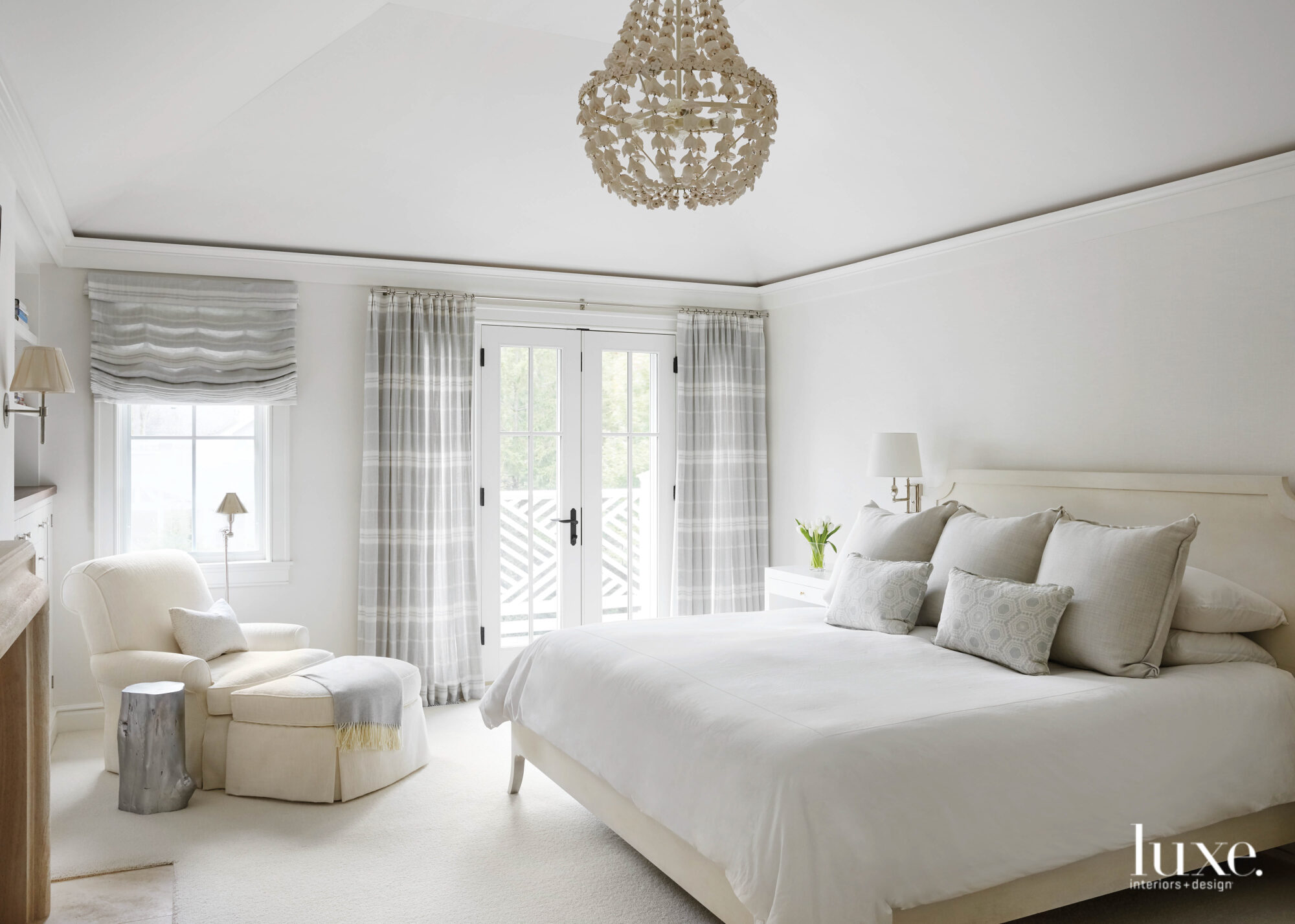 master bedroom with white and...