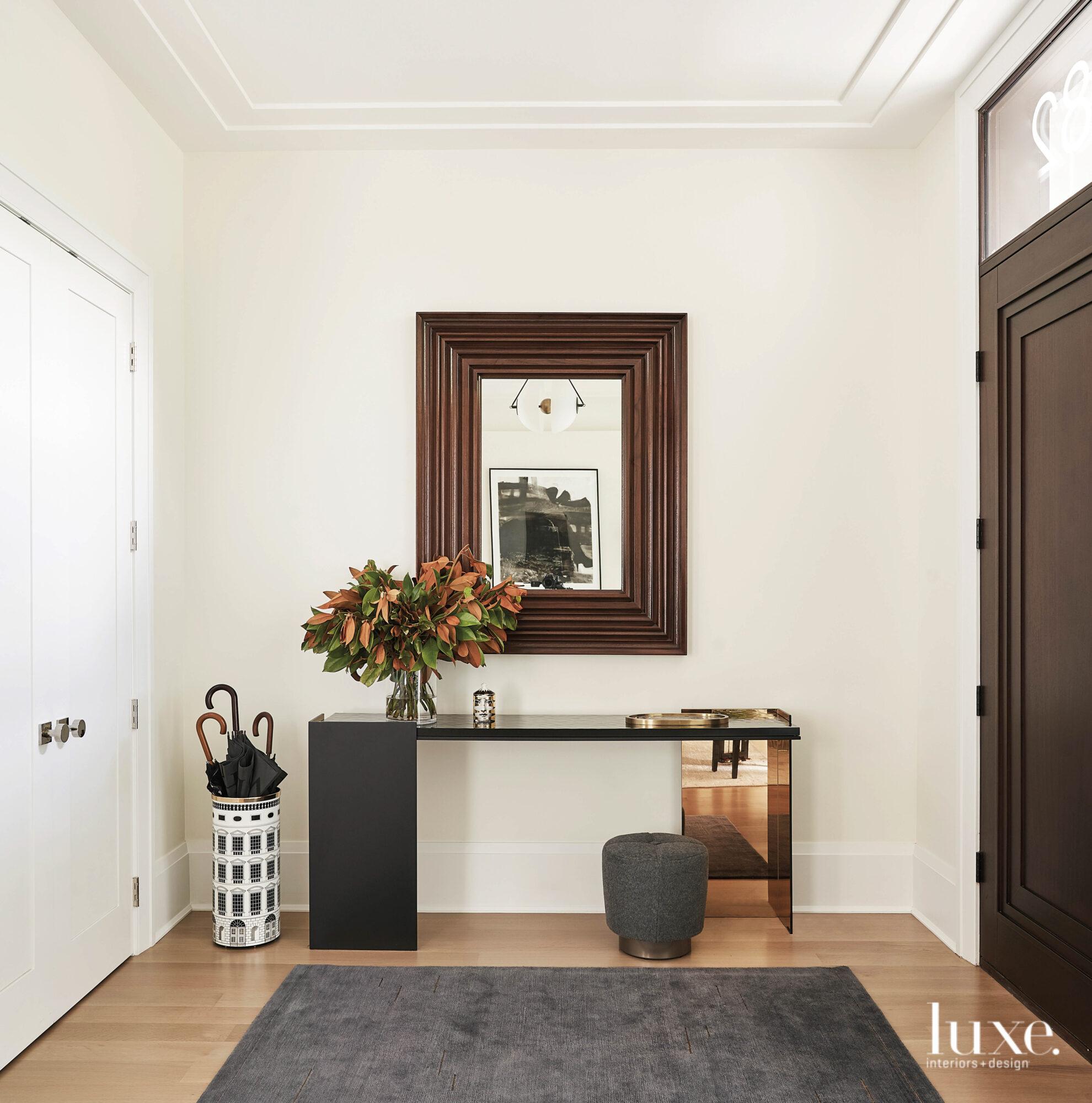 The foyer's gray rug, black...