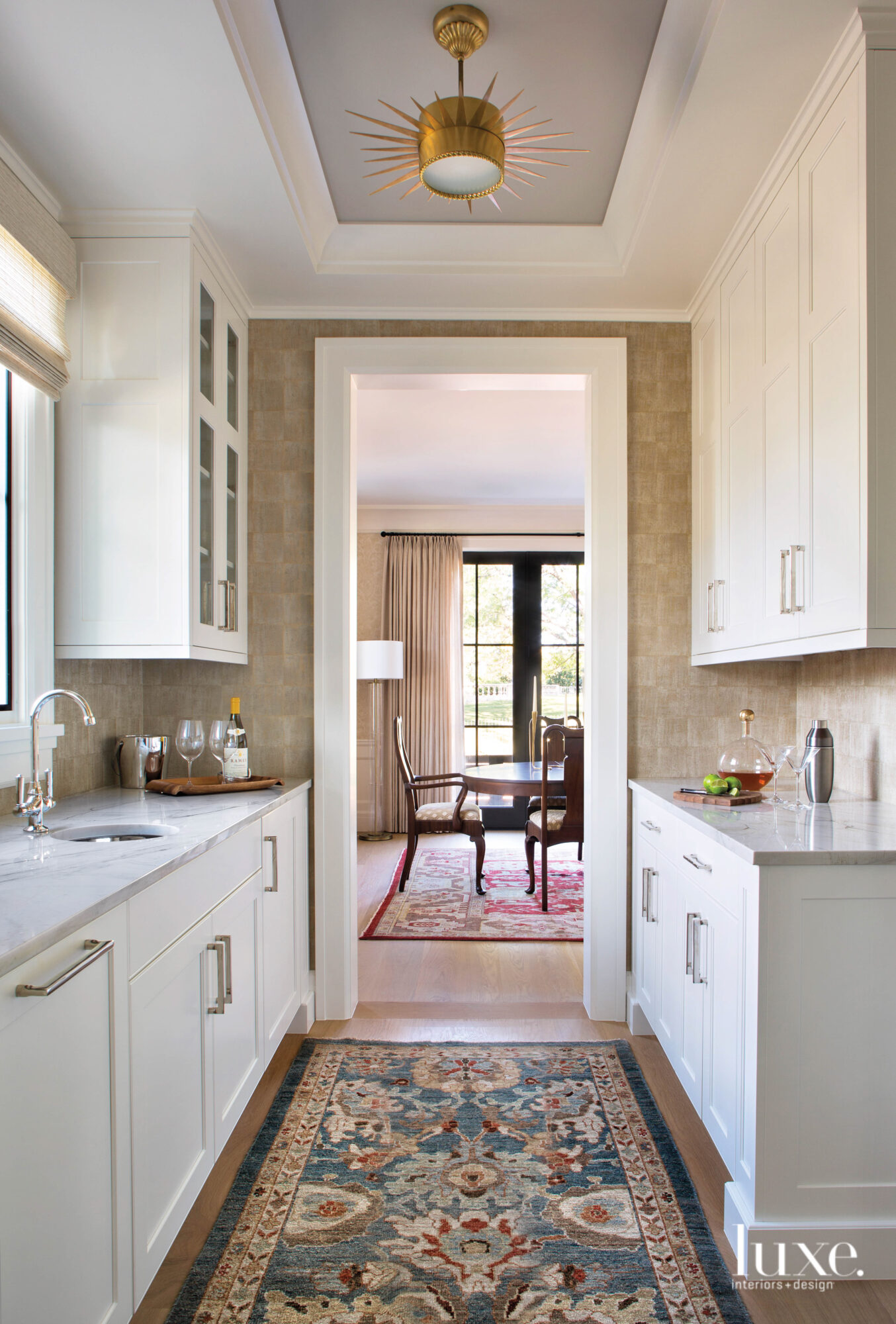 white kitchen with view of...
