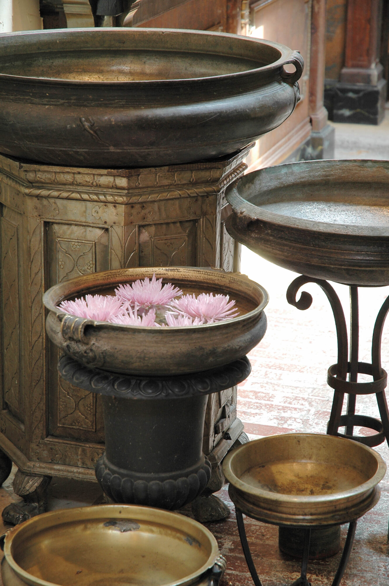 antique bowl holding floating flowers