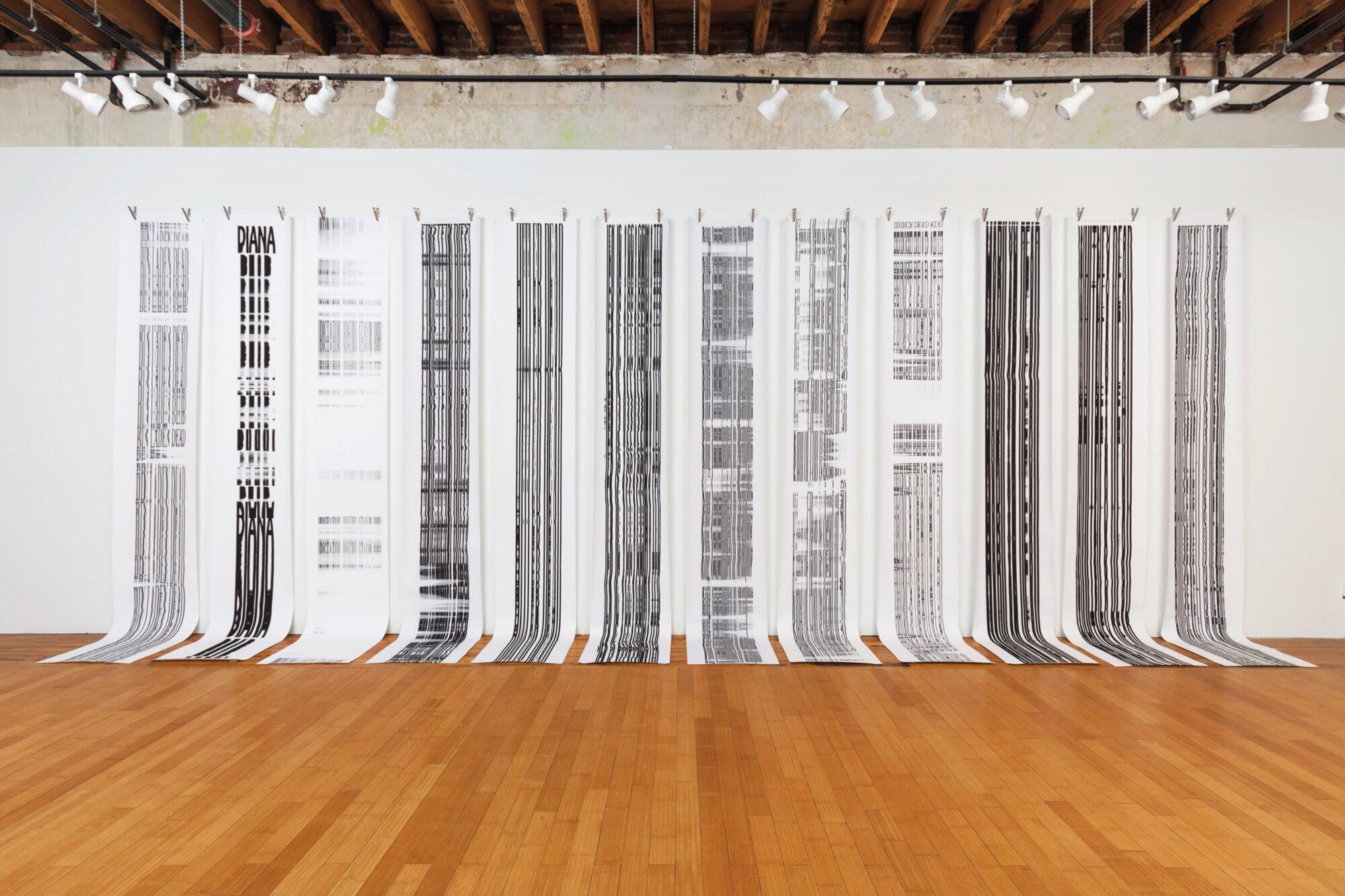 strips of artwork hanging on walls