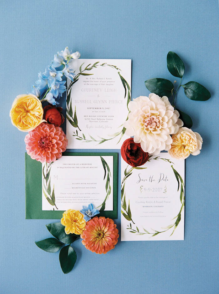 wedding invitations with flowers surrounding