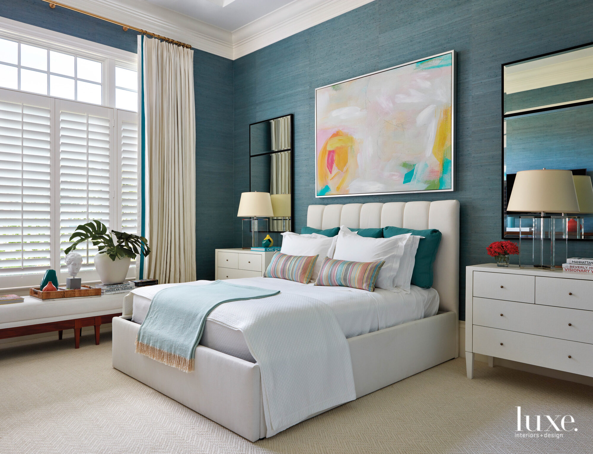 Bedroom with aqua wallcovering and...
