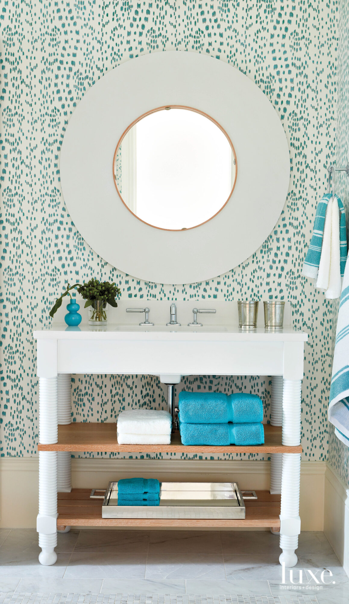 Guest bathroom with patterned wallcovering,...
