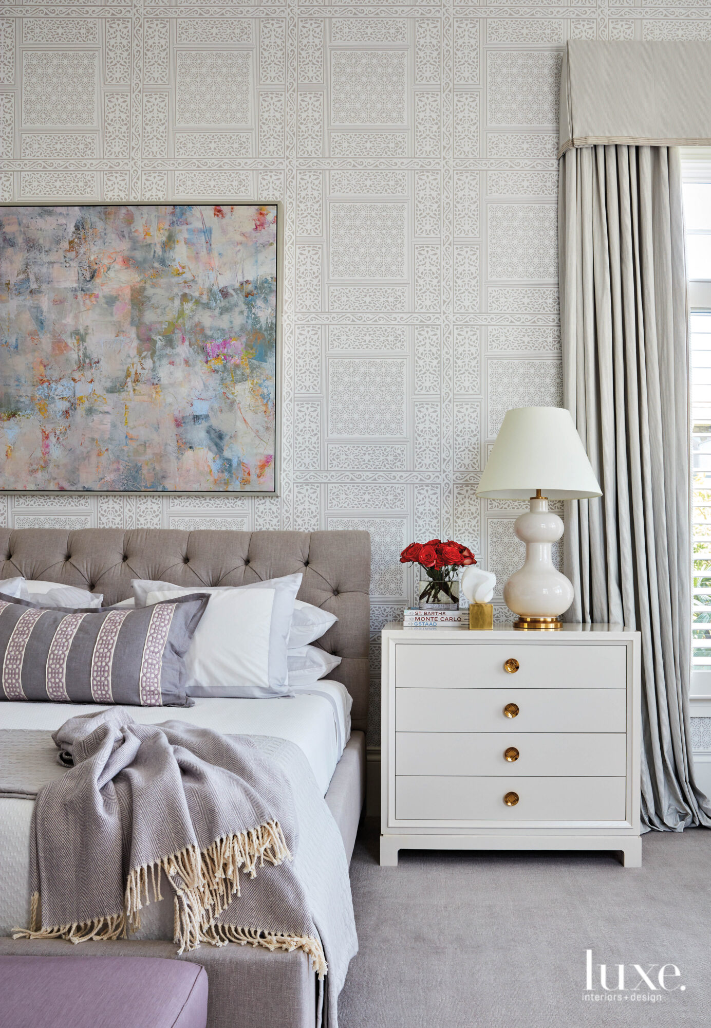 Master bedroom with gray bed,...