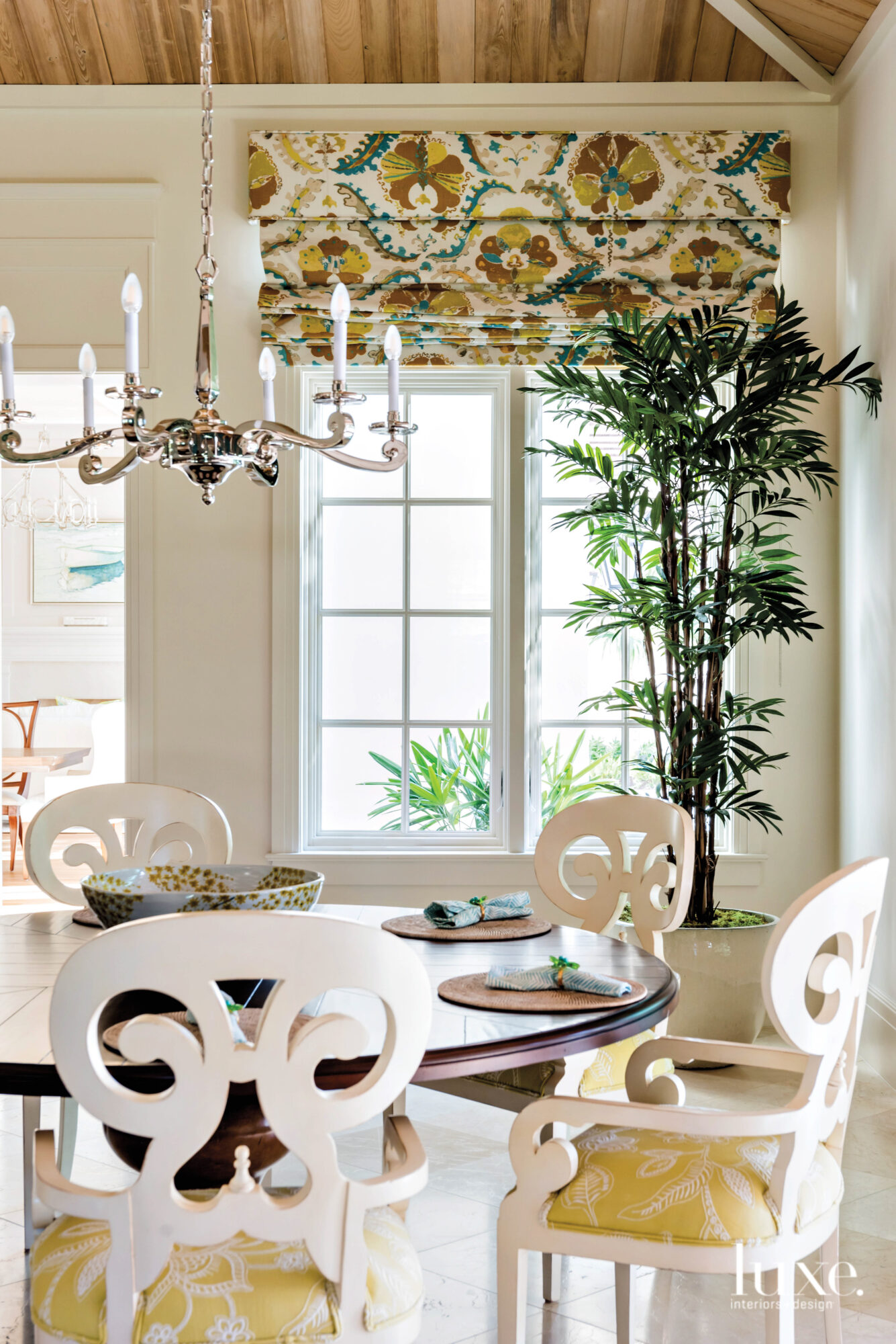 Dining area with yellow and...