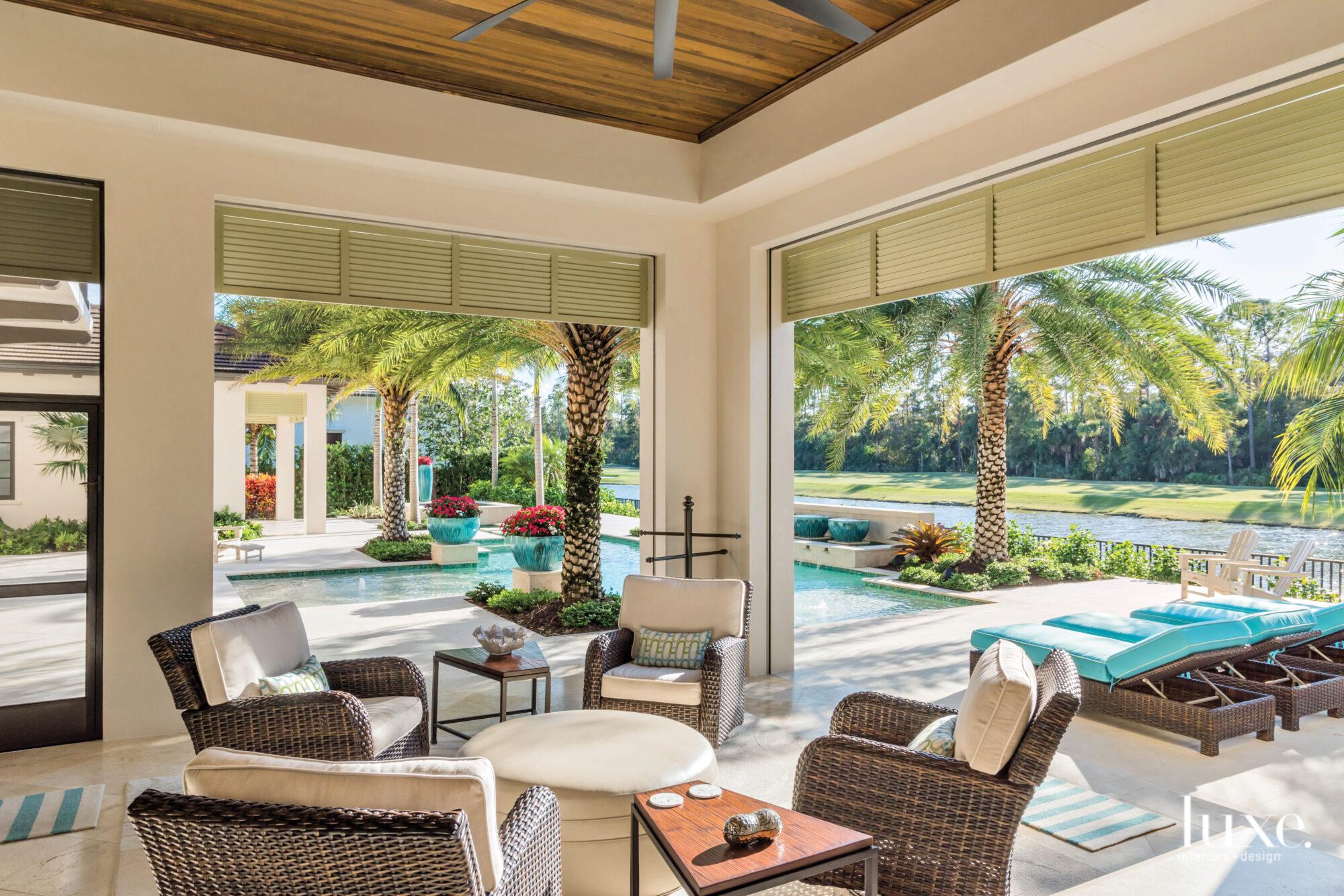 Outdoor living room overlooking pool.